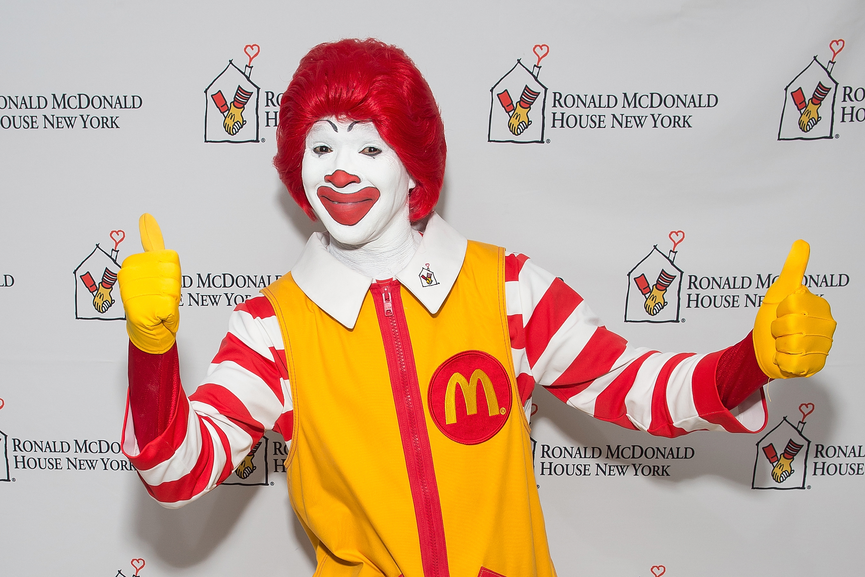 An attendee dressed as Ronald McDonald attends the 2014 Masquerade Ball