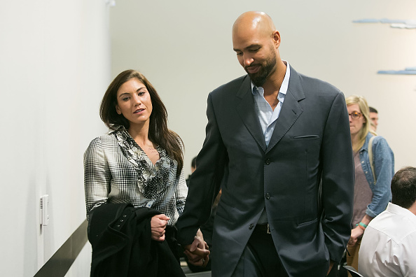 Hope Solo and husband Jerramy Stevens exit the court room at Kirkland Municipal Court in Washington on Nov. 4, 2014