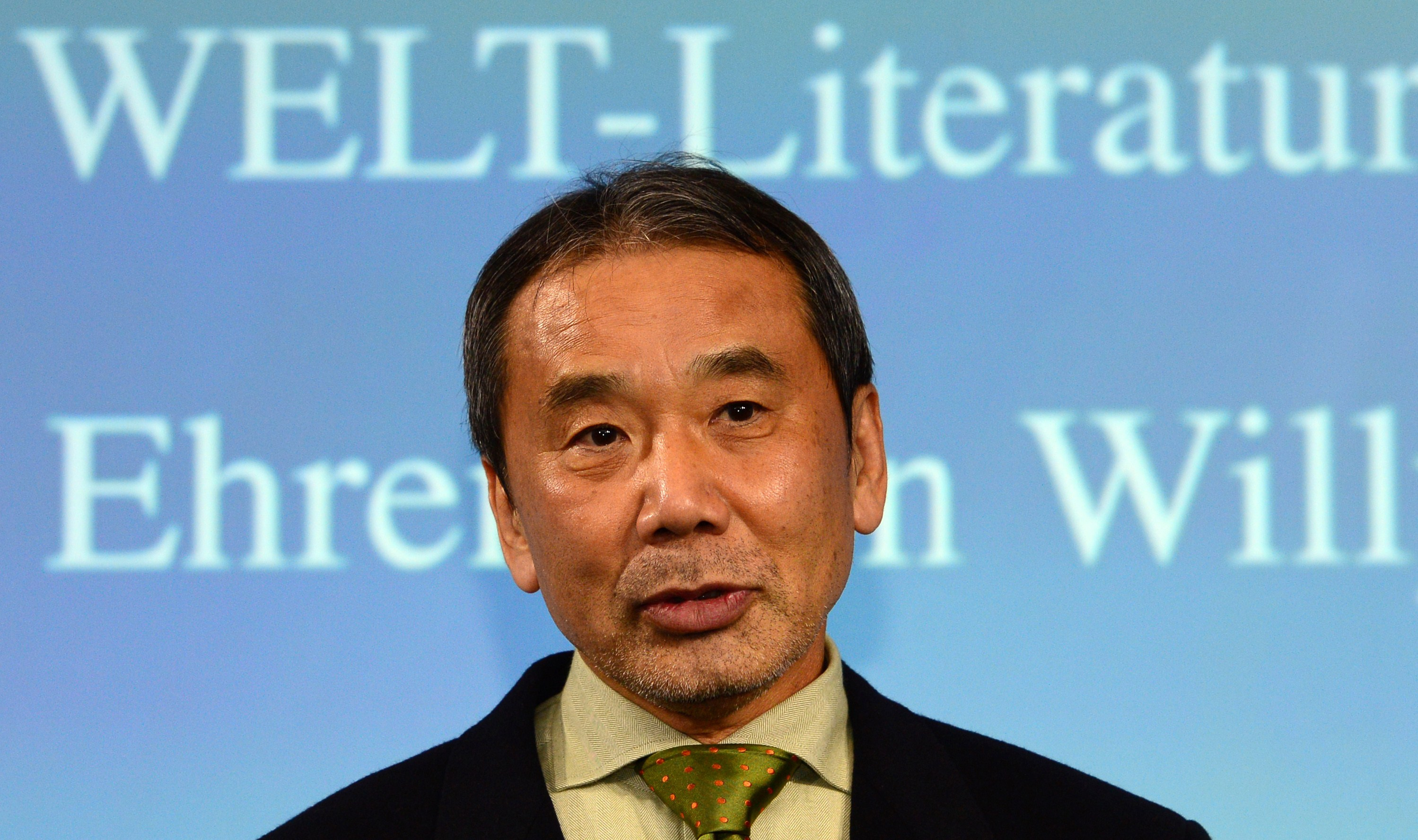 Japanese writer Haruki Murakami poses for photographers prior to an award ceremony for the Welt Literature Prize bestowed by the German daily Die Welt, in Berlin on Nov. 7, 2014