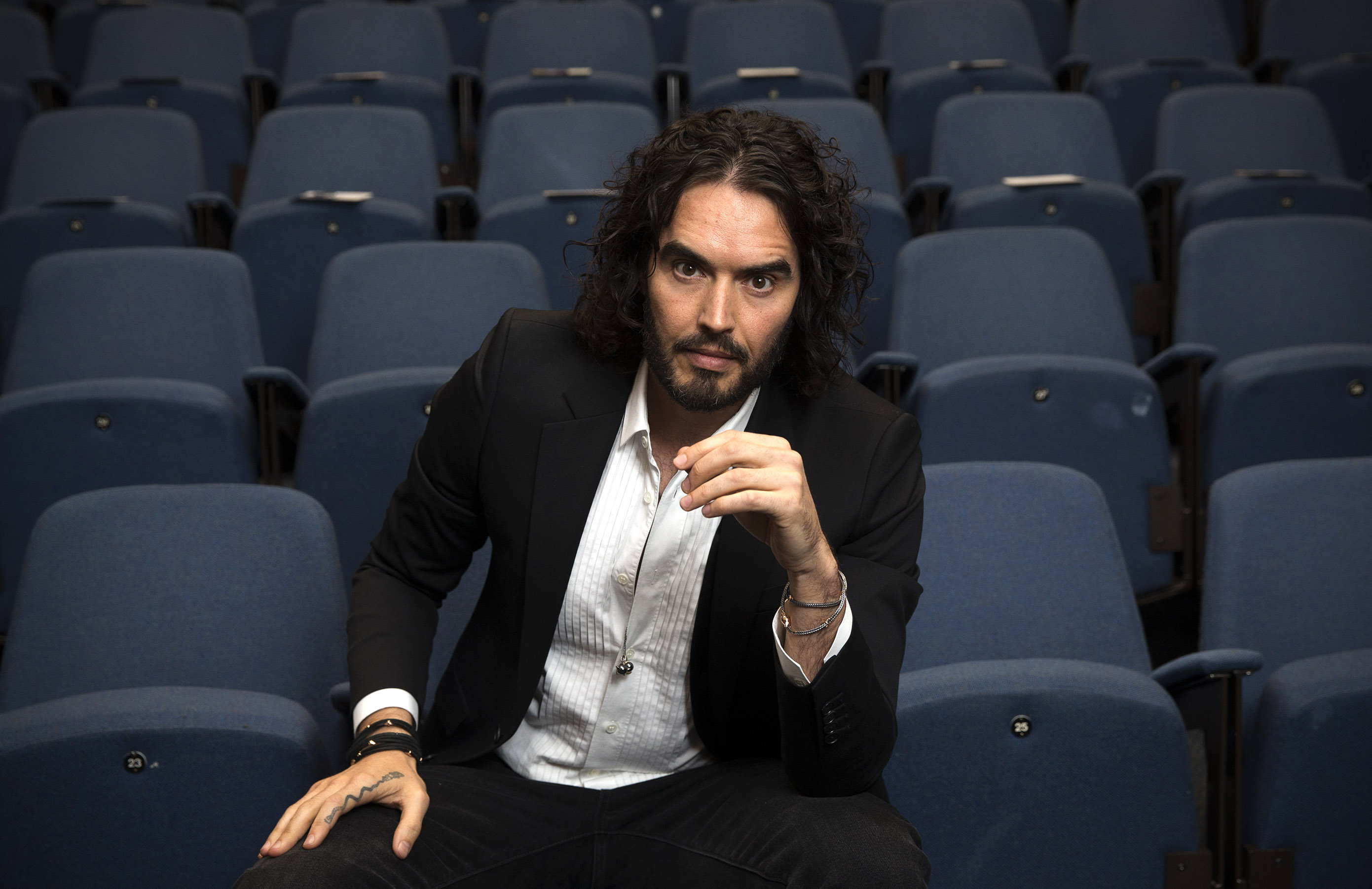 Russell Brand poses for photographs as he arrives to deliver The Reading Agency Lecture at The Institute of Education on Nov. 25, 2014 in London, England.