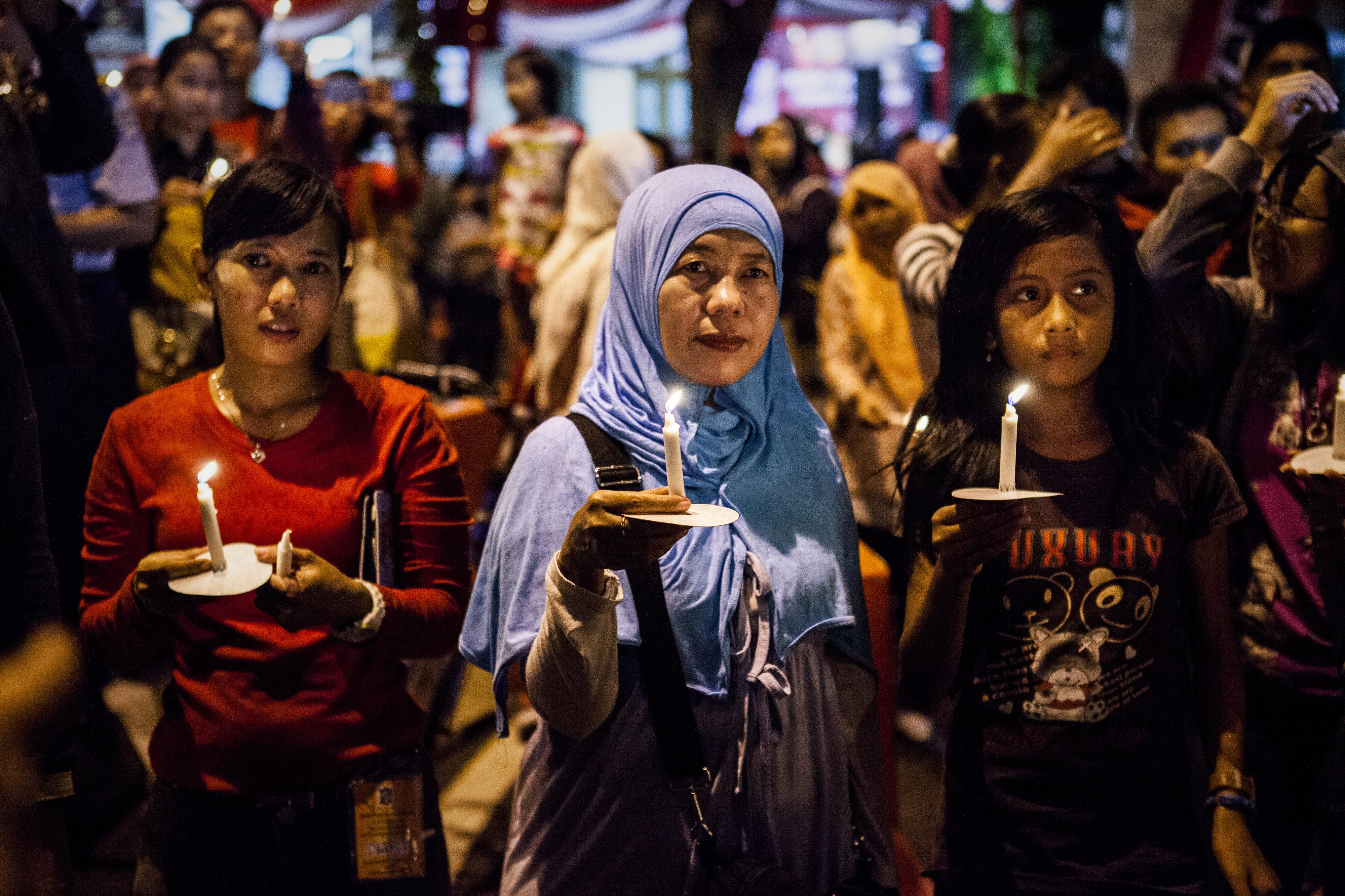 Residents pray for victims of AirAsia Flight QZ 8501 crash on Dec. 31, 2014, in Surabaya, Indonesia