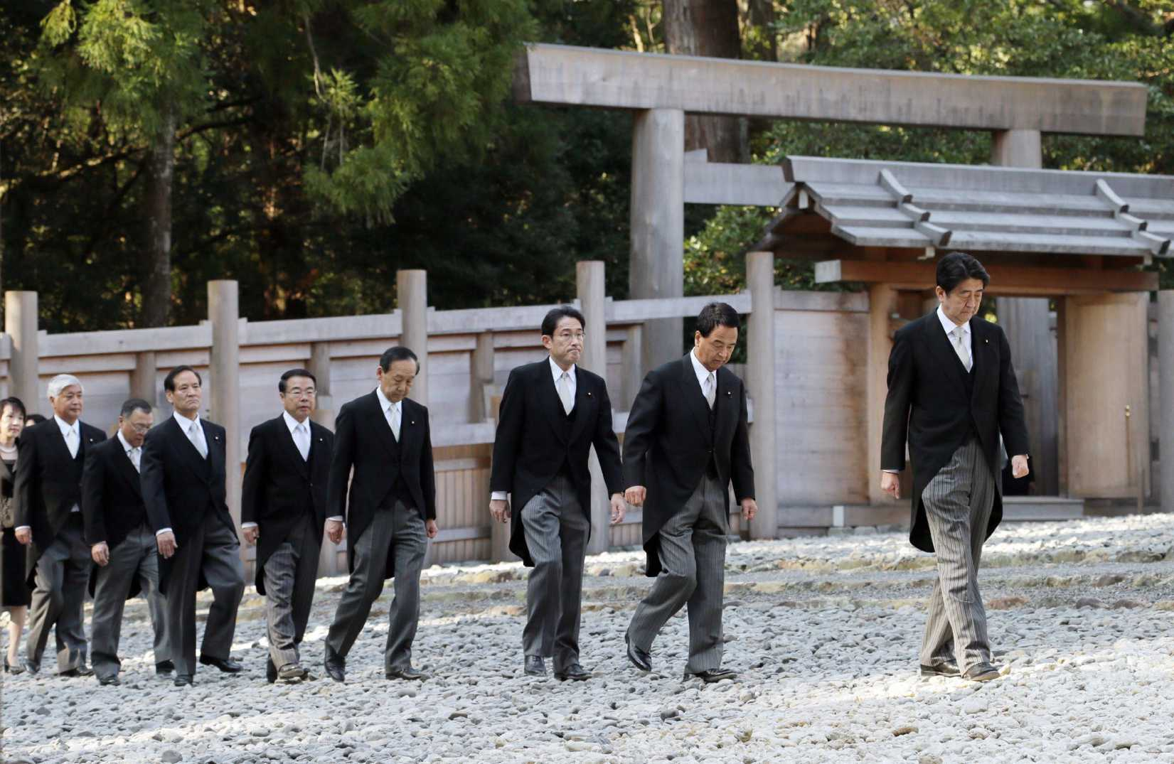 Japanese Prime Minister Shinzo Abe, right, and his Cabinet members visit the Ise shrine in Ise, in central Japan, on Jan. 5, 2015