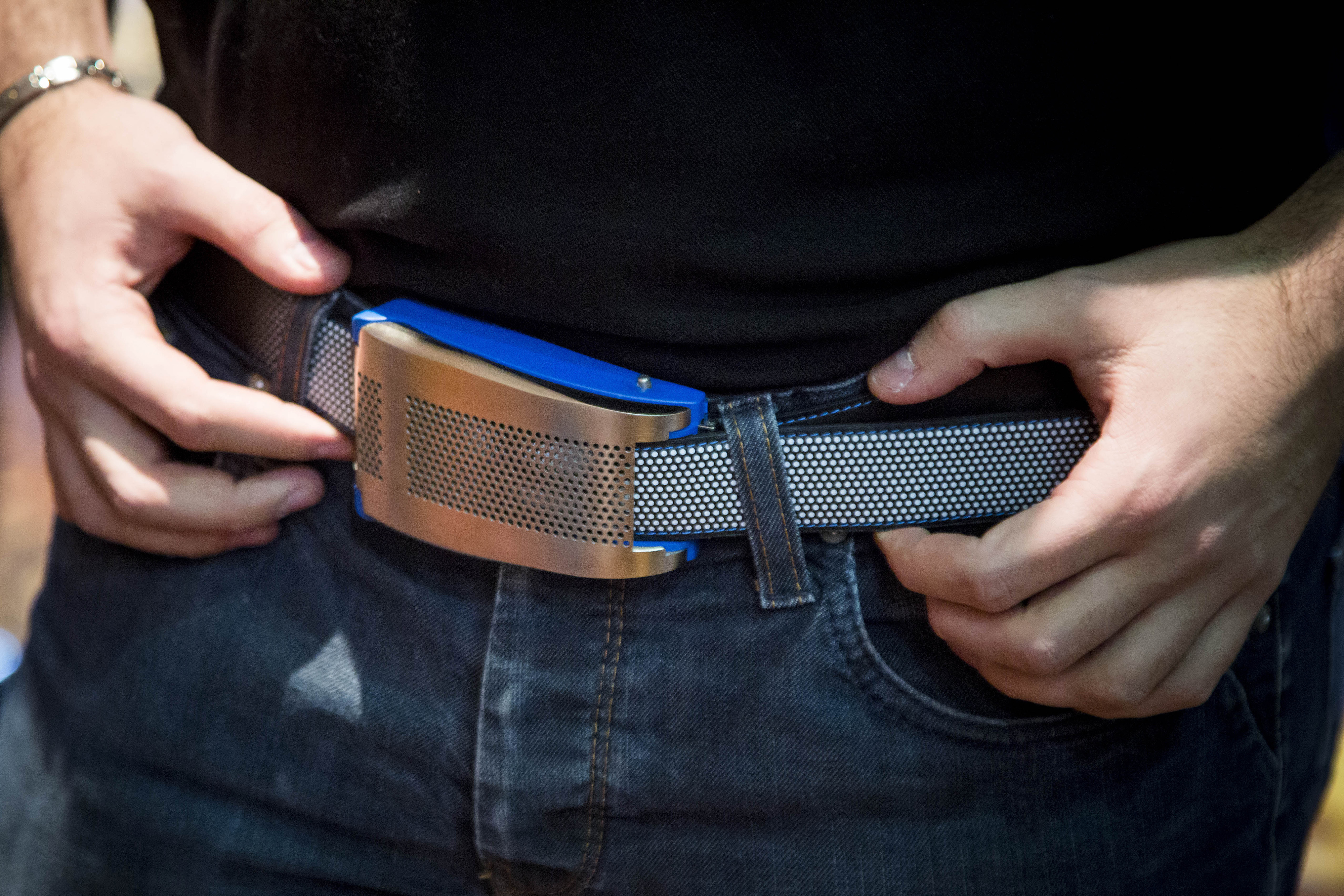 The Emiota smart belt is demonstrated at the CES Unveiled press event ahead of the 2015 Consumer Electronics Show in Las Vegas, Nevada, U.S., on Sunday, Jan. 4, 2015.