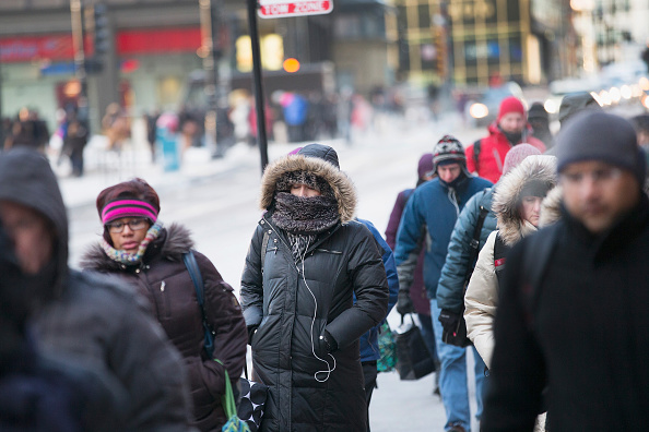 Commuters make their way to work as temperatures hovered around zero degrees Fahrenheit during the morning rush in Chicago on Jan. 5, 2015