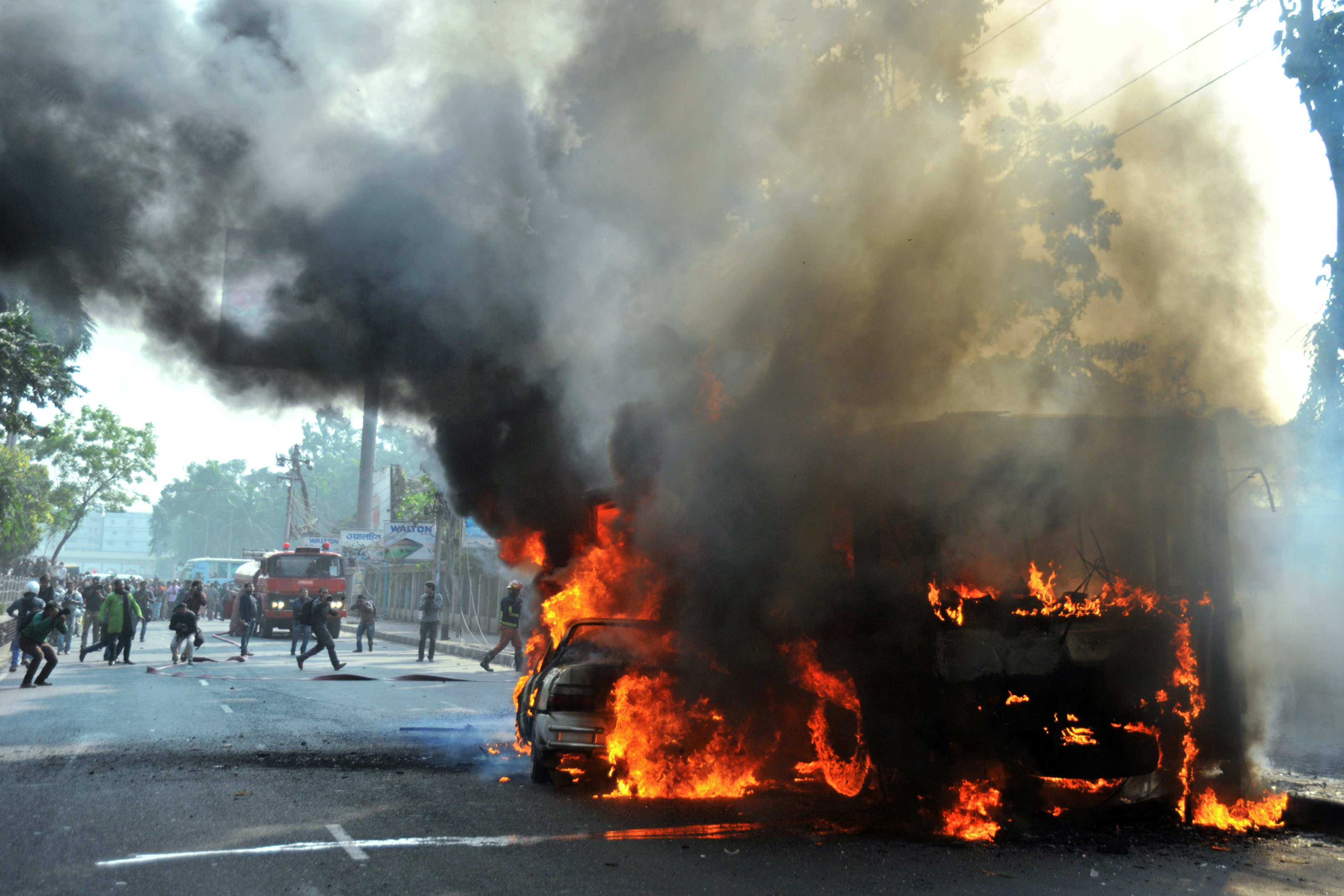 Burning vehicles, set on fire by opposition demonstrators, are pictured during violent protests in Dhaka, Bangladesh, on Jan. 6, 2015