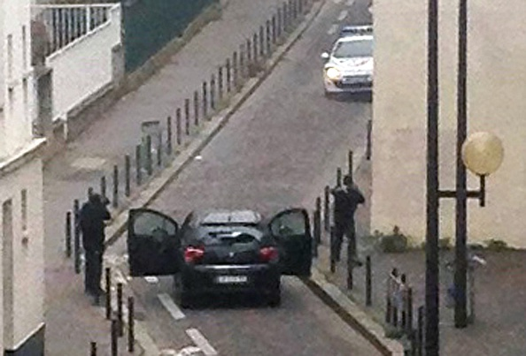 The Kouachi brothers face police after their killing spree inside the offices of Charlie Hebdo Jan. 7.