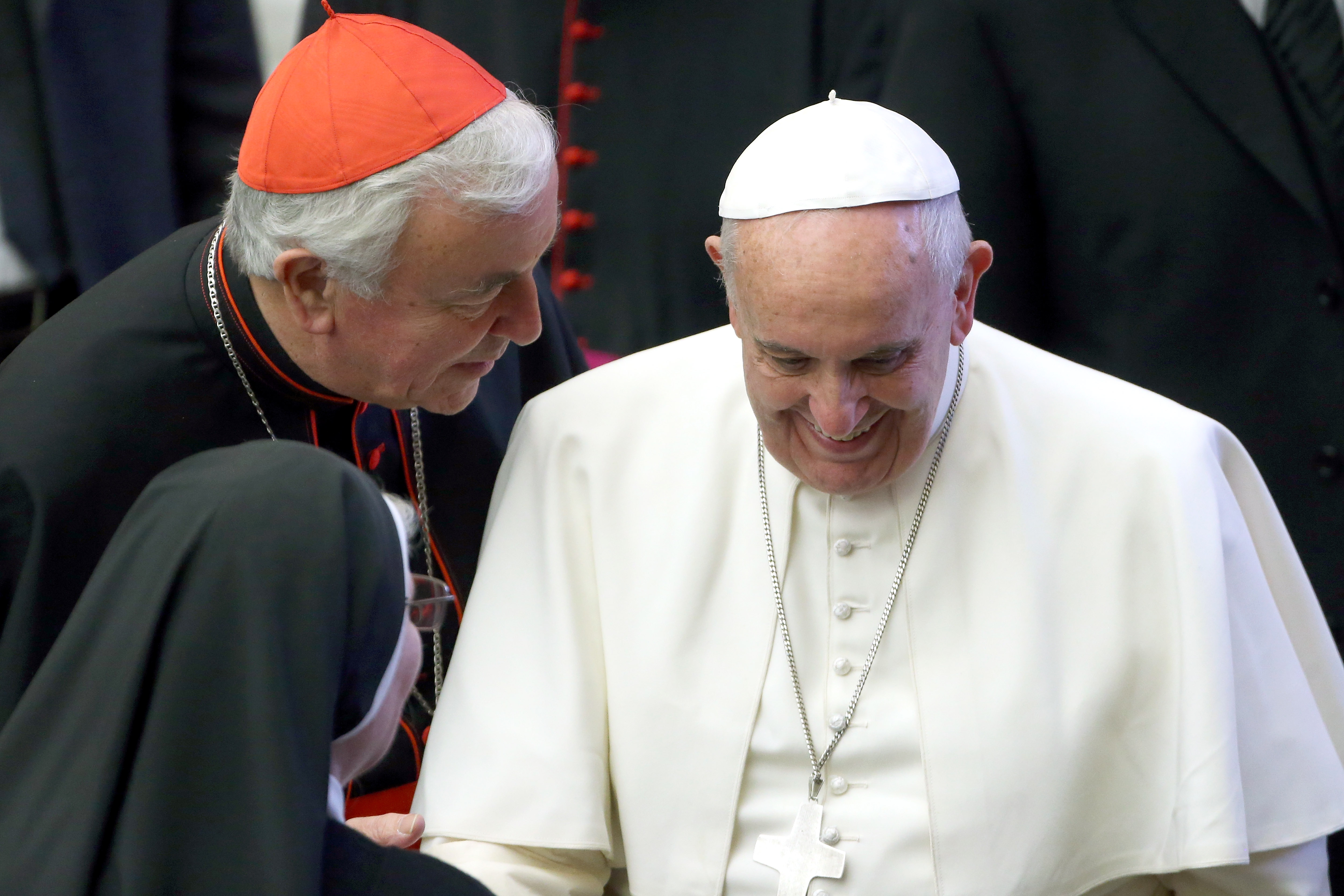 Pope Francis, flanked by the Archbishop of Westminster cardinal Vincent Nichols (L) greets a nun during the weekly general audience at the Paul VI Hall on January 7, 2015 in Vatican City, Vatican.