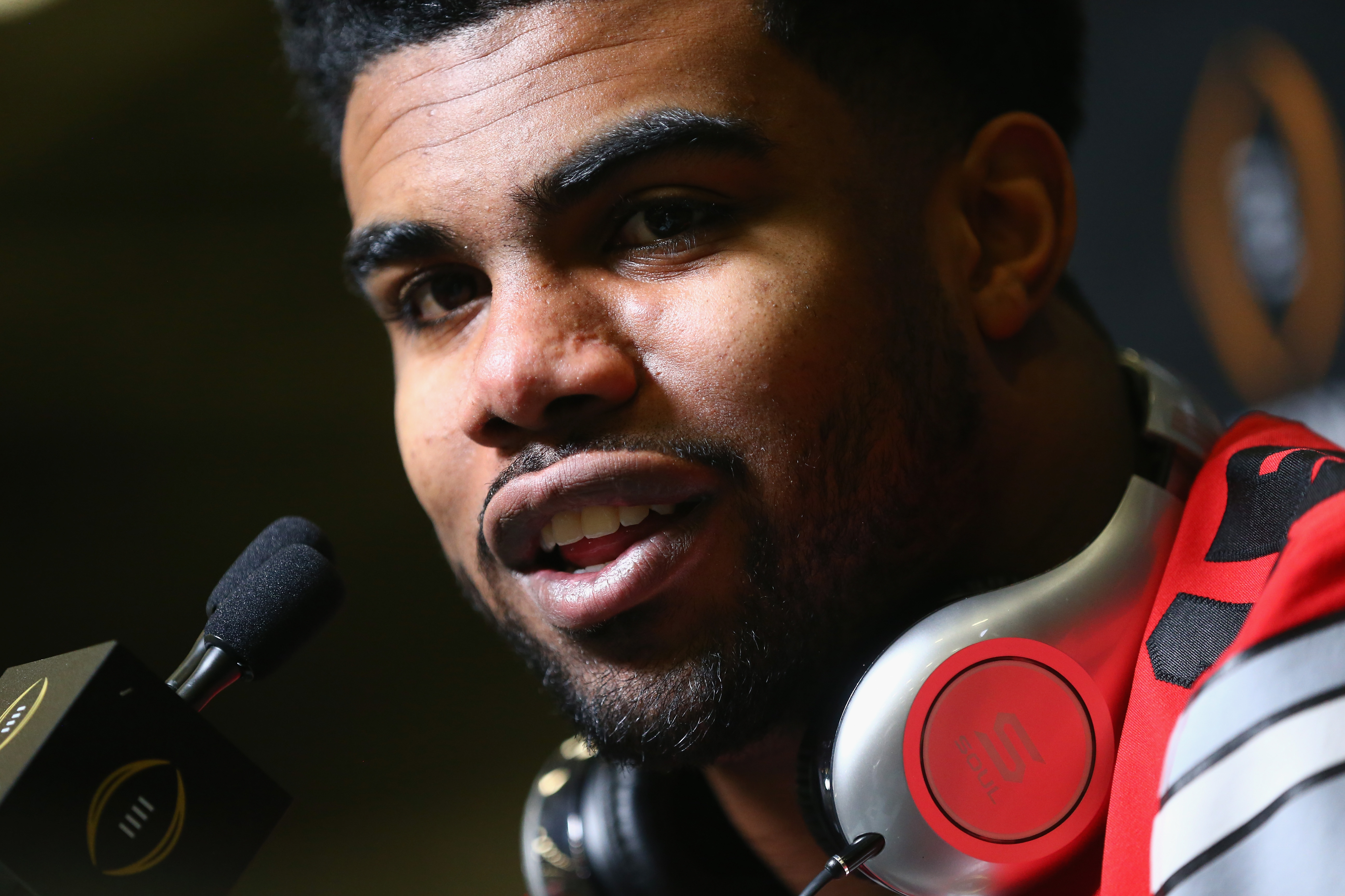 Ezekiel Elliott #15 of the Ohio State Buckeyes talks with media during Media Day for the College Football Playoff National Championship at Dallas Convention Center on January 10, 2015 in Dallas, Texas.