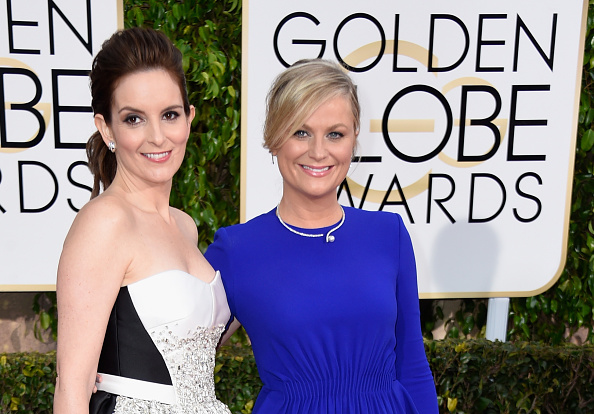 Tina Fey and Amy Poehler attend the 72nd Annual Golden Globe Awards at the Beverly Hilton Hotel in Los Angeles on Jan. 11, 2015