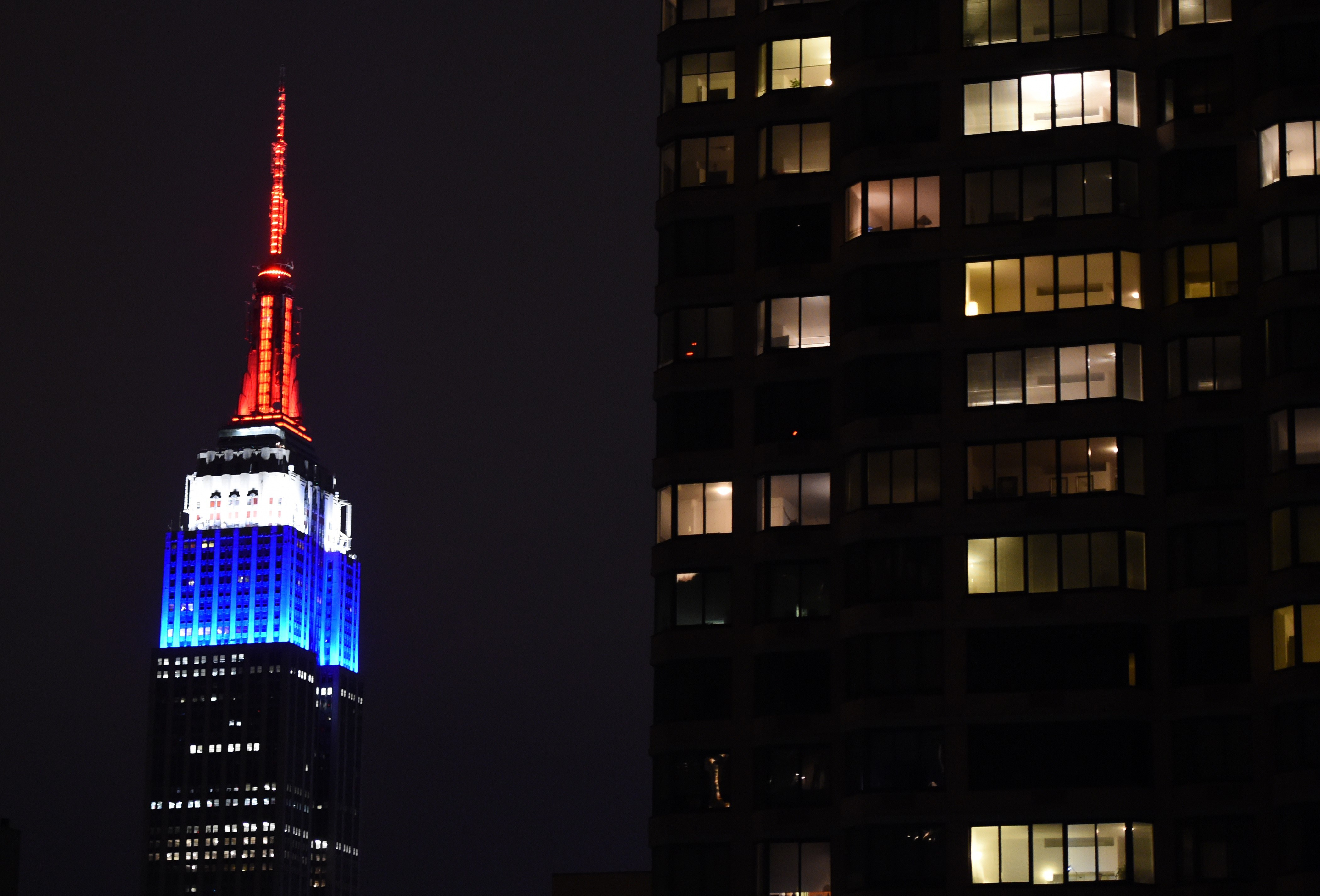 The Empire State building is lighted up in the colors of the French flag to pay tribute to those that lost their lives in the terrorist attacks at Charlie Hedbo on January 11, 2015 in New York.