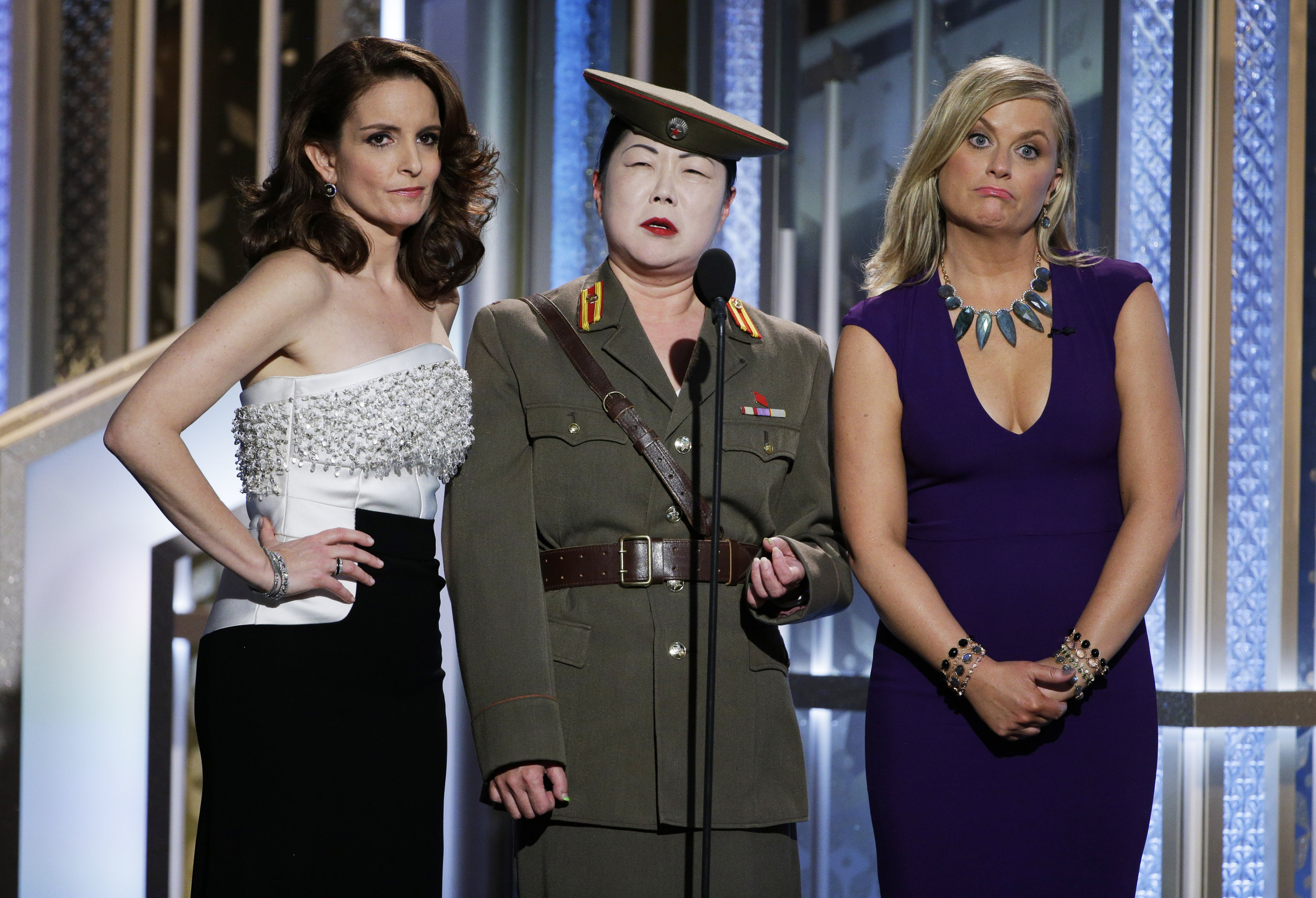 Tina Fey, Margaret Cho and, Amy Poehler speak onstage during the 72nd Annual Golden Globe Awards.