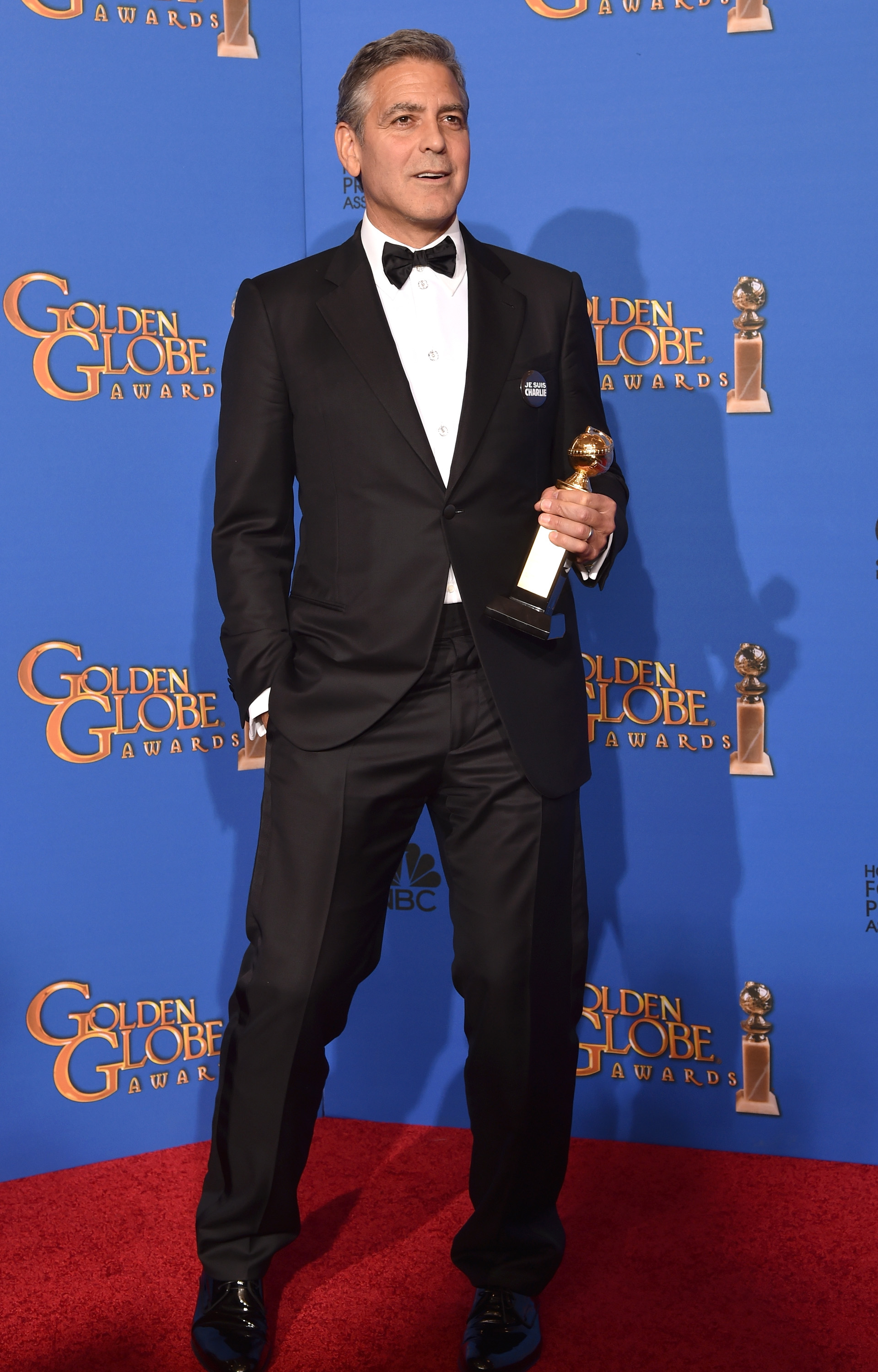 Actor/director George Clooney, recipient of the Cecil B. DeMille Award, poses in the press room