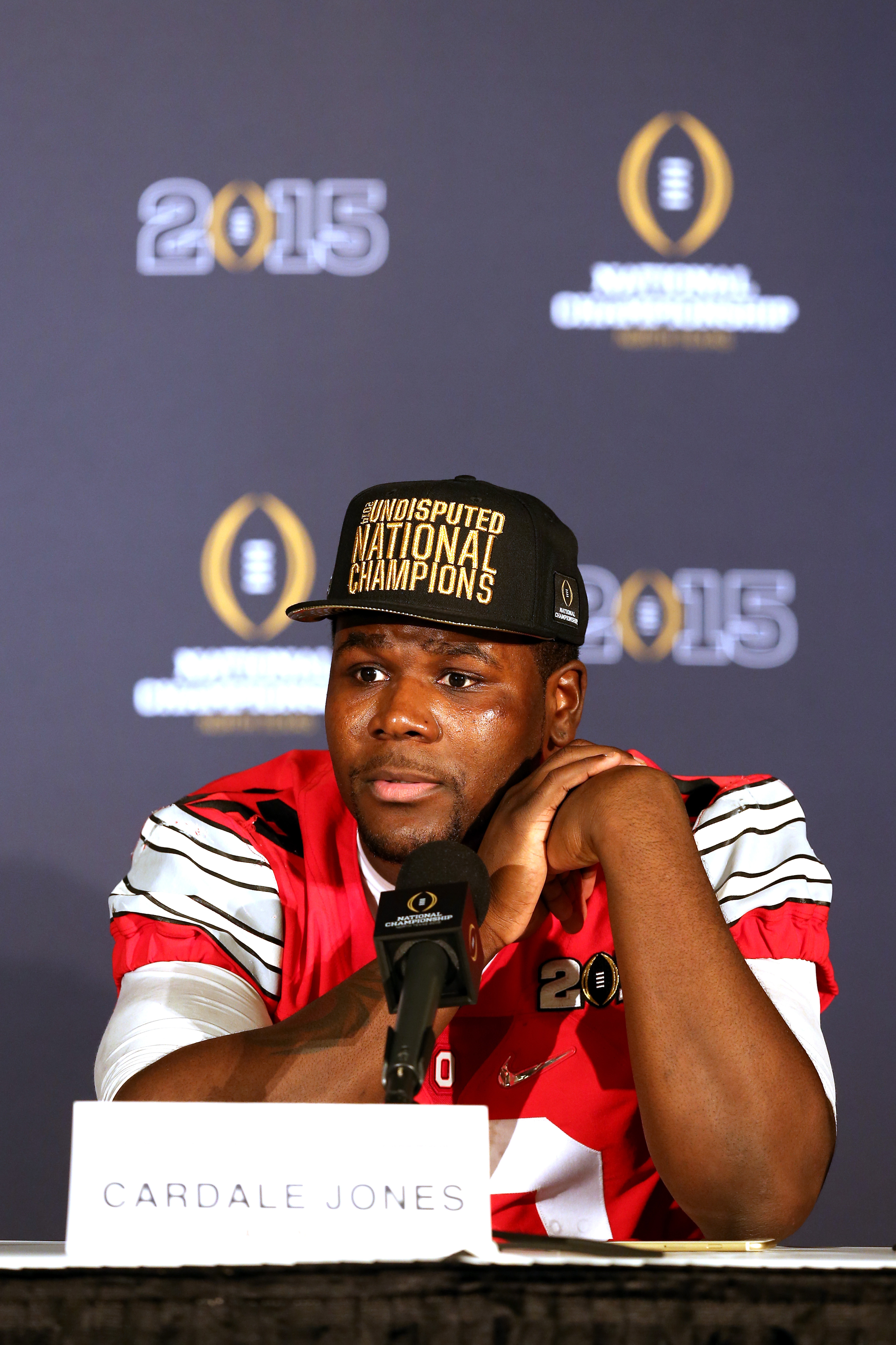 Quarterback Cardale Jones #12 of the Ohio State Buckeyes talks to the media after defeating the Oregon Ducks in the College Football Playoff National Championship Game at AT&T Stadium on January 12, 2015 in Arlington, Texas.  The Ohio State Buckeyes defeated the Oregon Ducks 42 to 20.