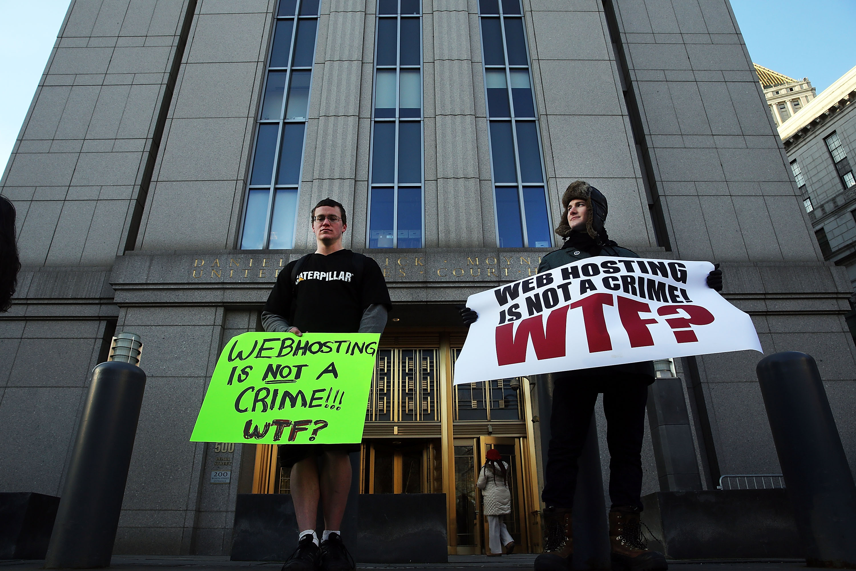 Supporters of Ross Ulbricht, the alleged creator and operator of the Silk Road underground market, stand in front of a Manhattan federal court house on the first day of jury selection for his trial on January 13, 2015 in New York City.