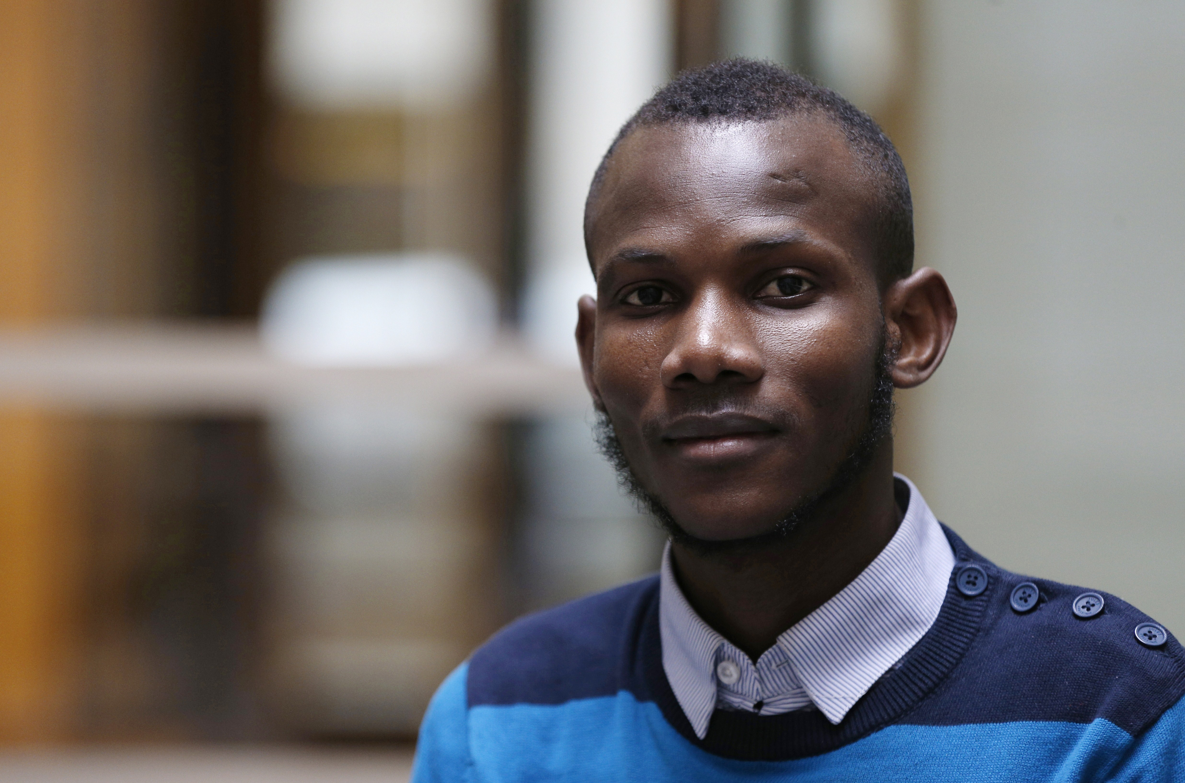 Malian Lassana Bathily, a Muslim employee who helped Jewish shoppers hide in a cold storage room from an islamist gunman during the Jan. 9 attack, poses on Jan. 15, 2015 in Paris.