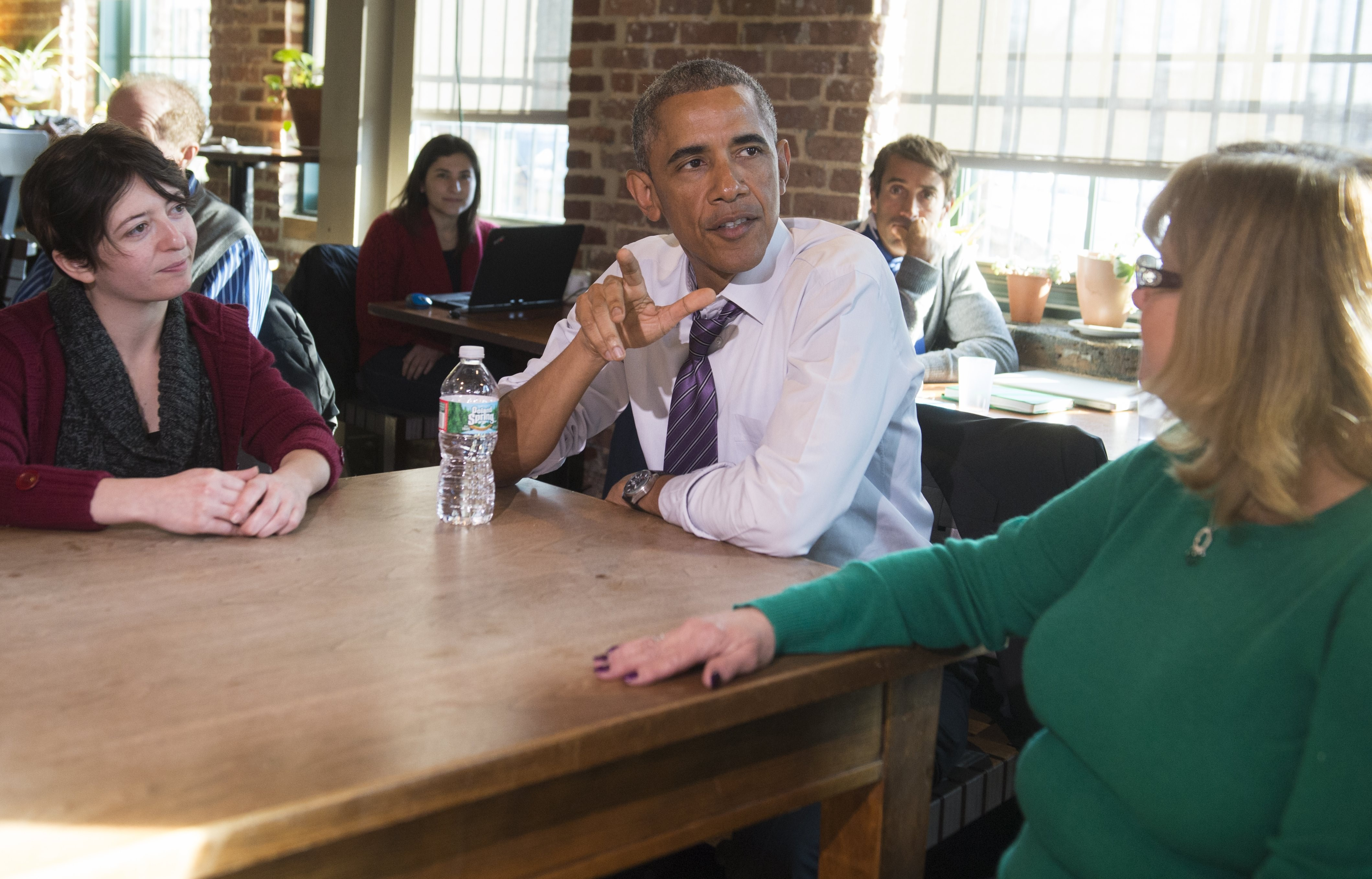 U.S. President Barack Obama speaks about increasing family leave for working Americans with Mary Stein, right, and Amanda Rothschild, left, after having lunch  in Baltimore
