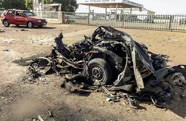 Wreckage of a car is seen after a suicide bombing which killed at least five people and injured many others in Potiskum of Yobe State in Nigeria on Jan. 18, 2015