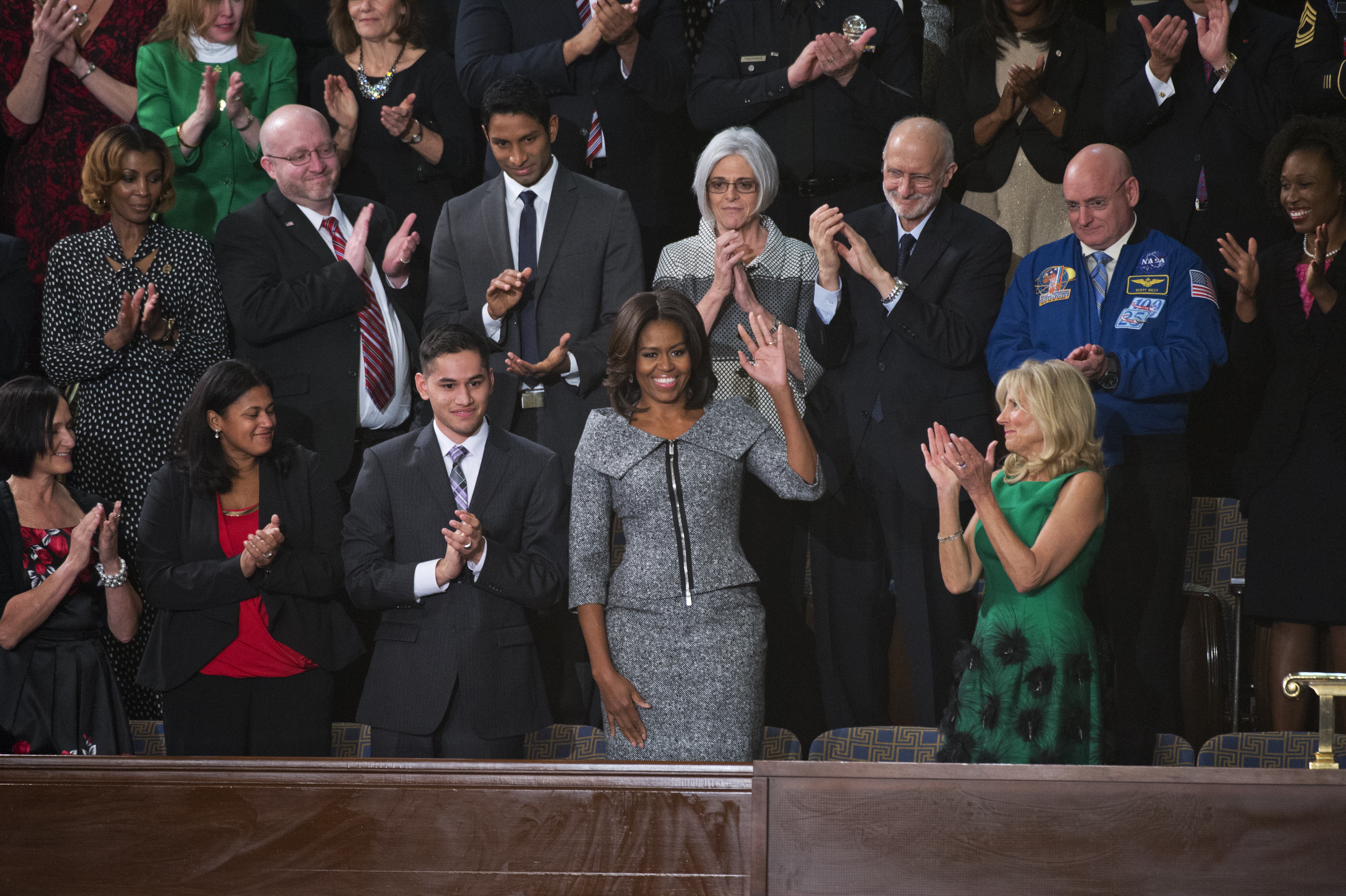 First Lady Michelle Obama arrives in the Capitol's House chamber before President Barack Obama's State of the Union address, January 20, 2015.