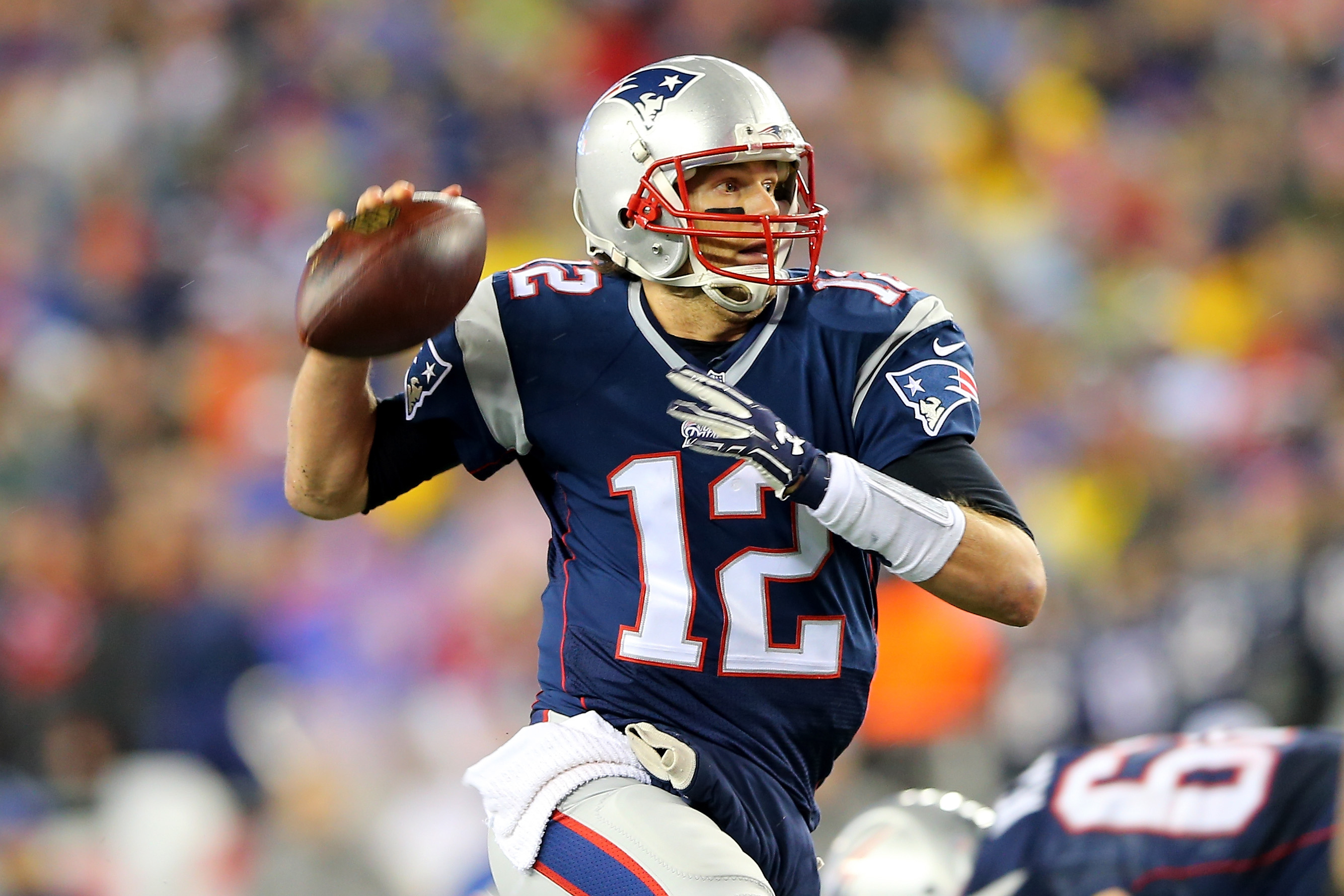 Tom Brady #12 of the New England Patriots in action against the Indianapolis Colts of the 2015 AFC Championship Game at Gillette Stadium on January 18, 2015 in Foxboro, Massachusetts.
