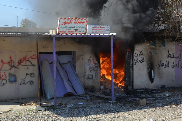 Buildings burn Saturday during a military operation launched by the Iraqi army to retake positions held by Islamic State outside the village Sharween, north of Baghdad.