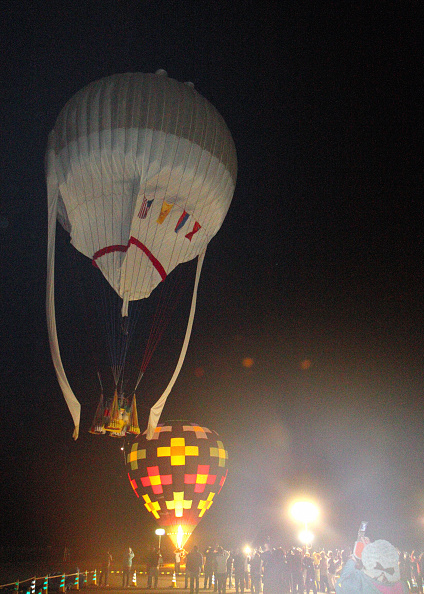 A hot-air balloon of the U.S. balloonist Troy Bradley and Russian Leonid Tiukhtyaev soars in Saga, Japan, on Jan. 25, 2015