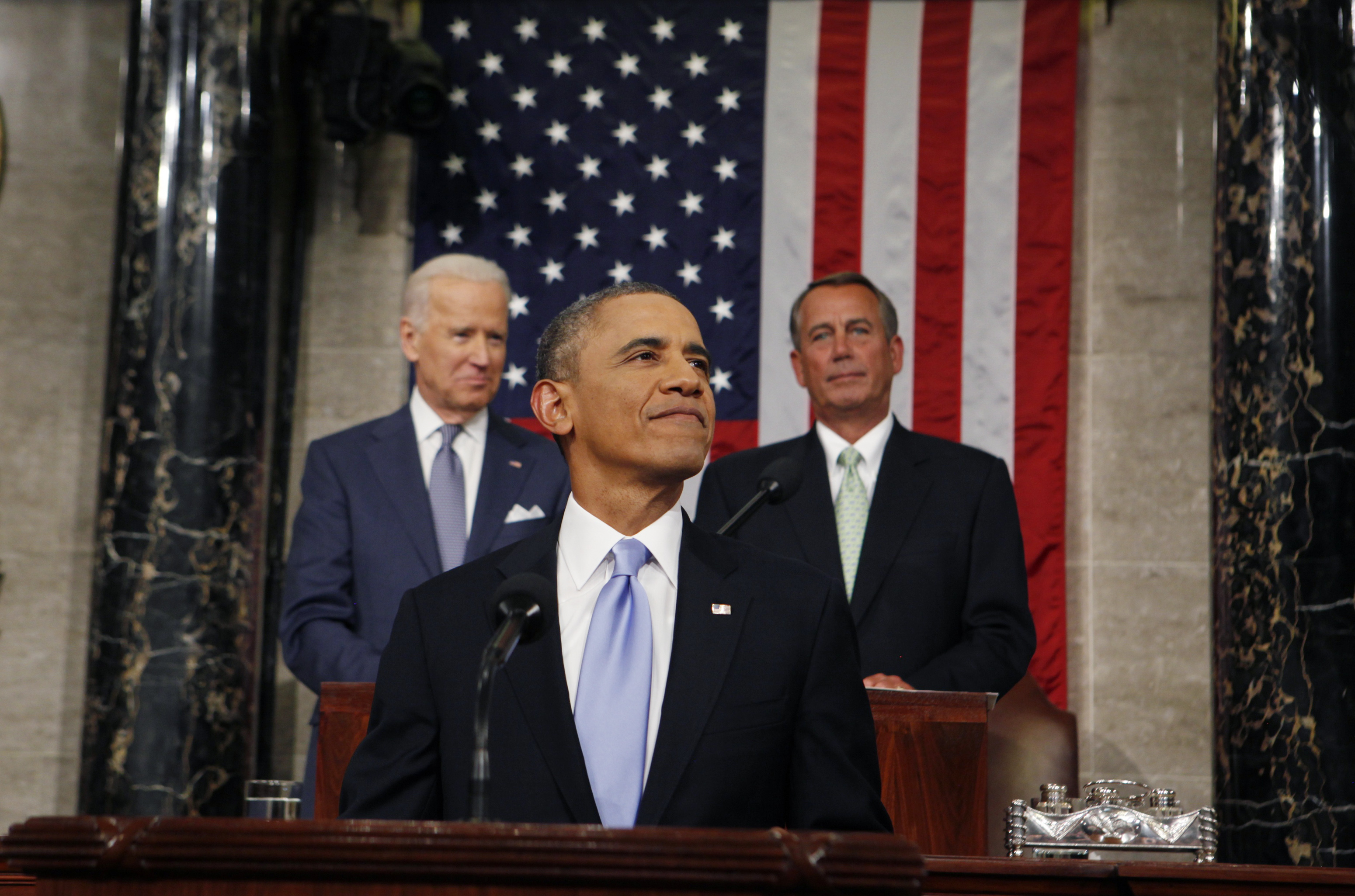 U.S. President Barack Obama smiles as he arrives to deliver his State of the Union speech on Capitol Hill in Washington on January 28, 2014.