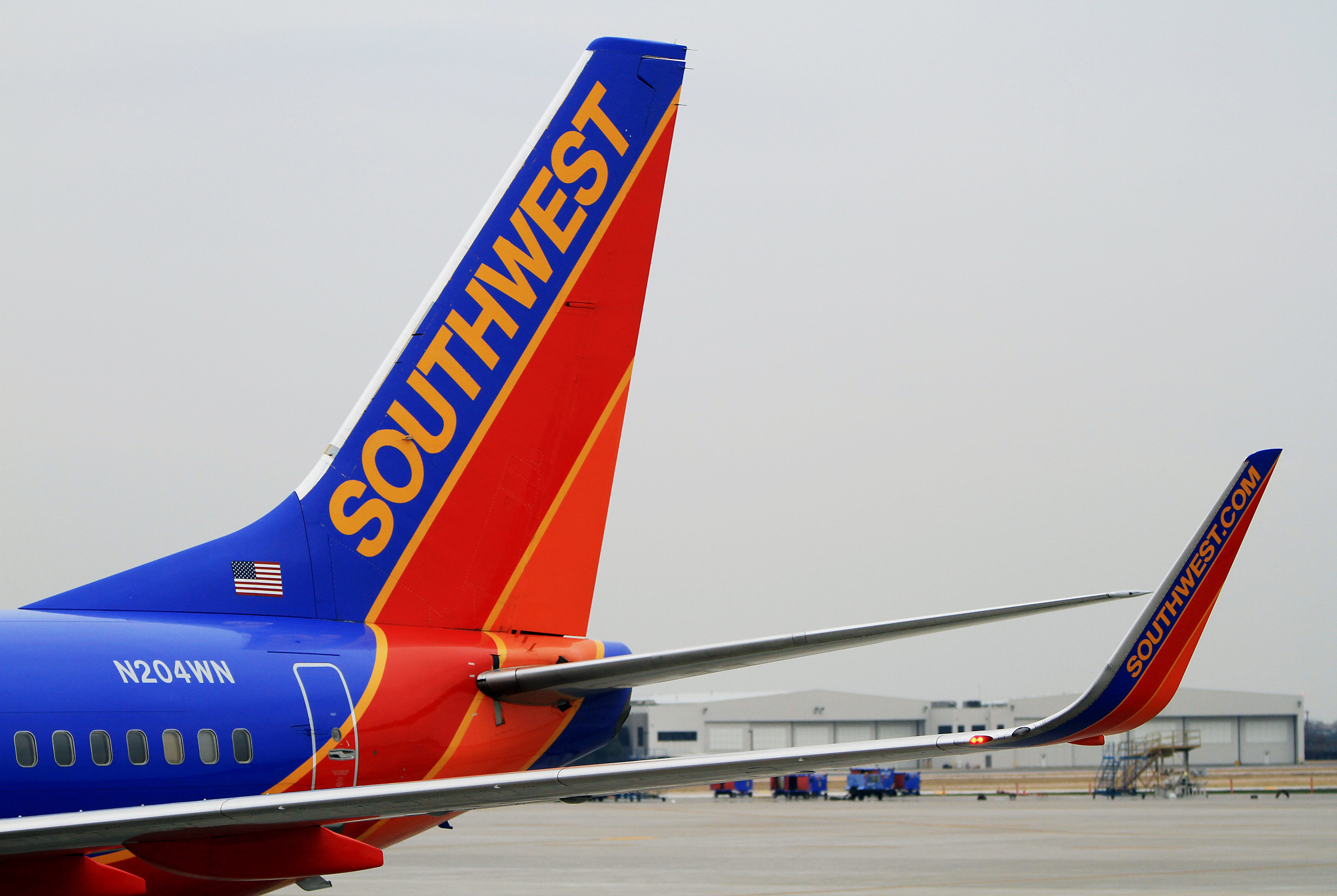 A Southwest Airlines Co. Boeing 737-7H4 plane sits at a gate at Dallas Love Field Airport in Dallas, Texas, U.S., on Monday, Feb. 3, 2014.
