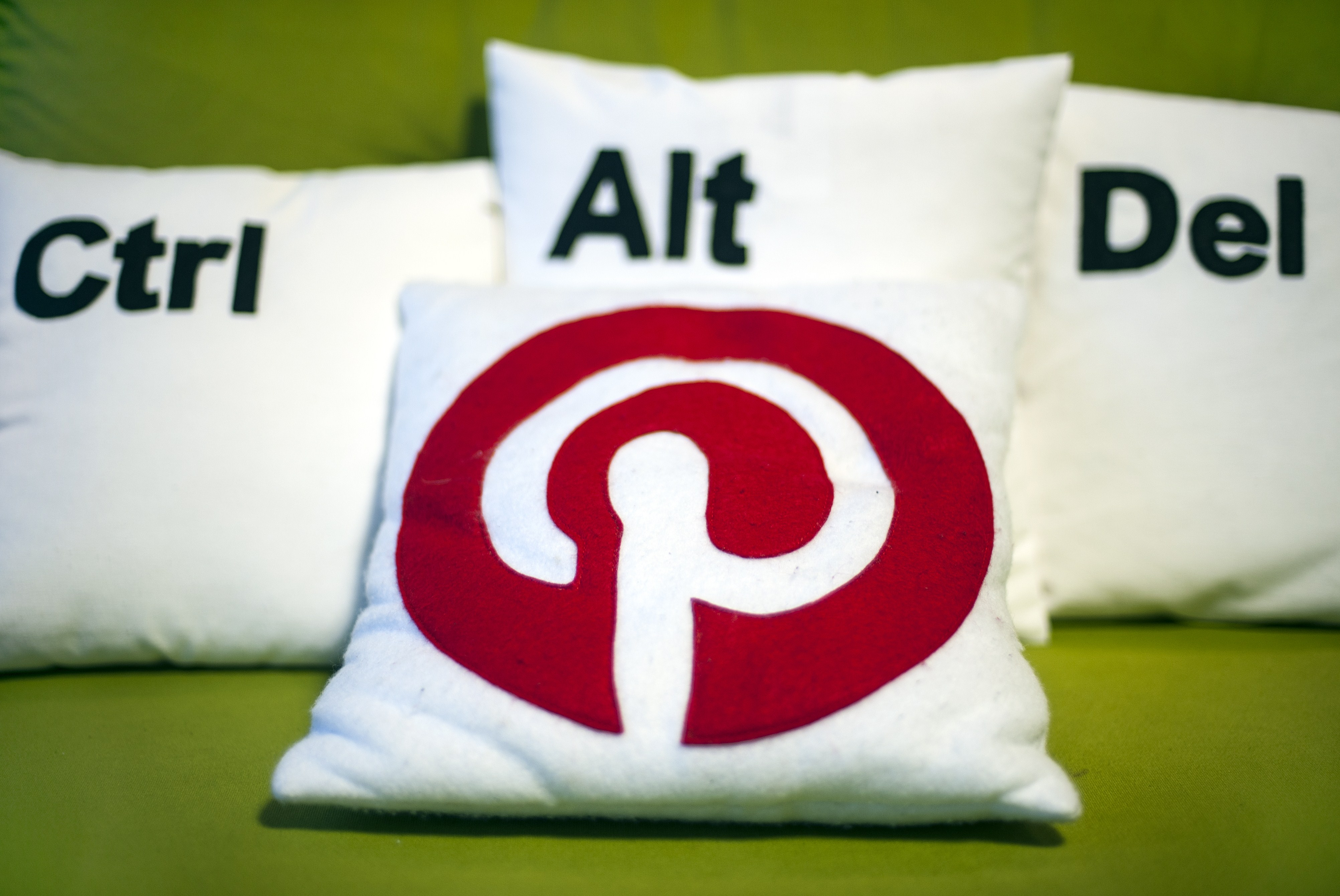Decorative pillows set the scene at a Pinterest media event at the company's corporate headquarters office in San Francisco, California on April 24, 2014.