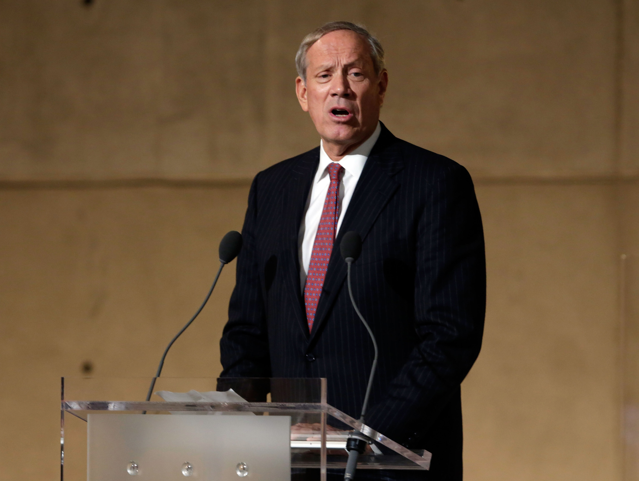 Former New York Gov. George Pataki speaks during the dedication ceremony in Foundation Hall at the National September 11 Memorial Museum at ground zero in New York City on May 15, 2014.