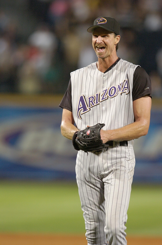 Randy Johnson smiles after pitching a perfect game between the Arizona Diamondbacks and the Atlanta Braves at Turner Field in Atlanta on May 18, 2004.