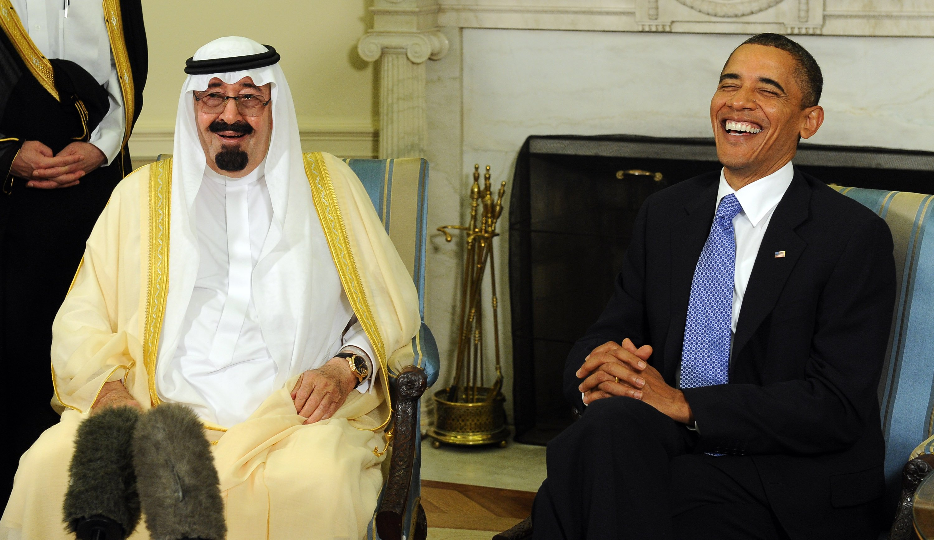 U.S. President Barack Obama and Saudi Arabian King Abdullah laugh as they speak to the media after their meeting in the Oval Office of the White House, in Washington, D.C., on June 29, 2010