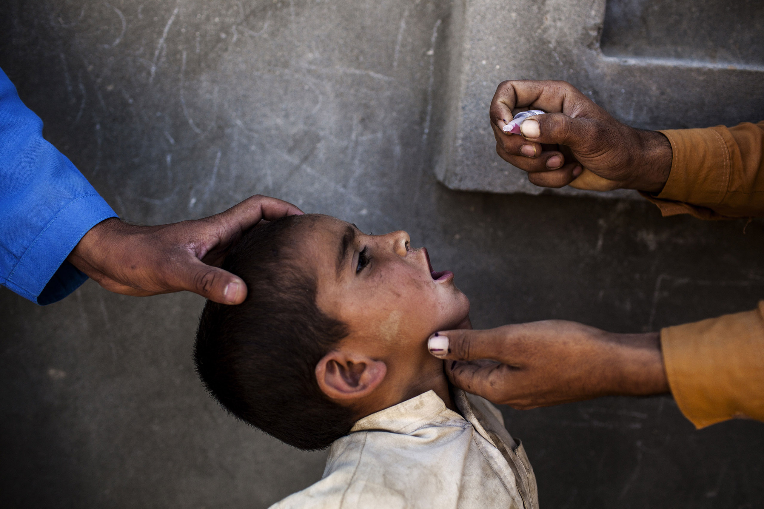 A child in Afghanistan is vaccinated against polio. Global rates of childhood vaccination have skyrocketed