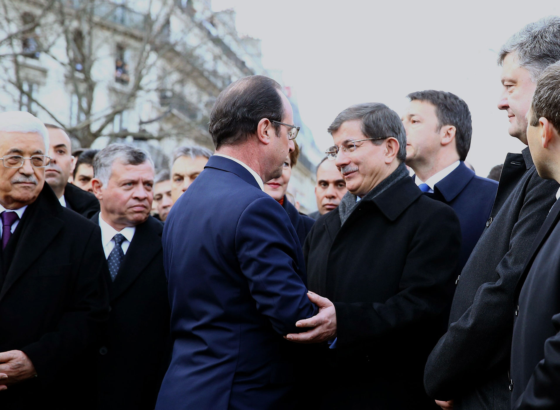 Turkish Prime Minister Ahmet Davutoglu, center right, talks to French President Francois Hollande, center left, during the Unity March 'Marche Republicaine' in Paris, France on Jan. 11, 2014.