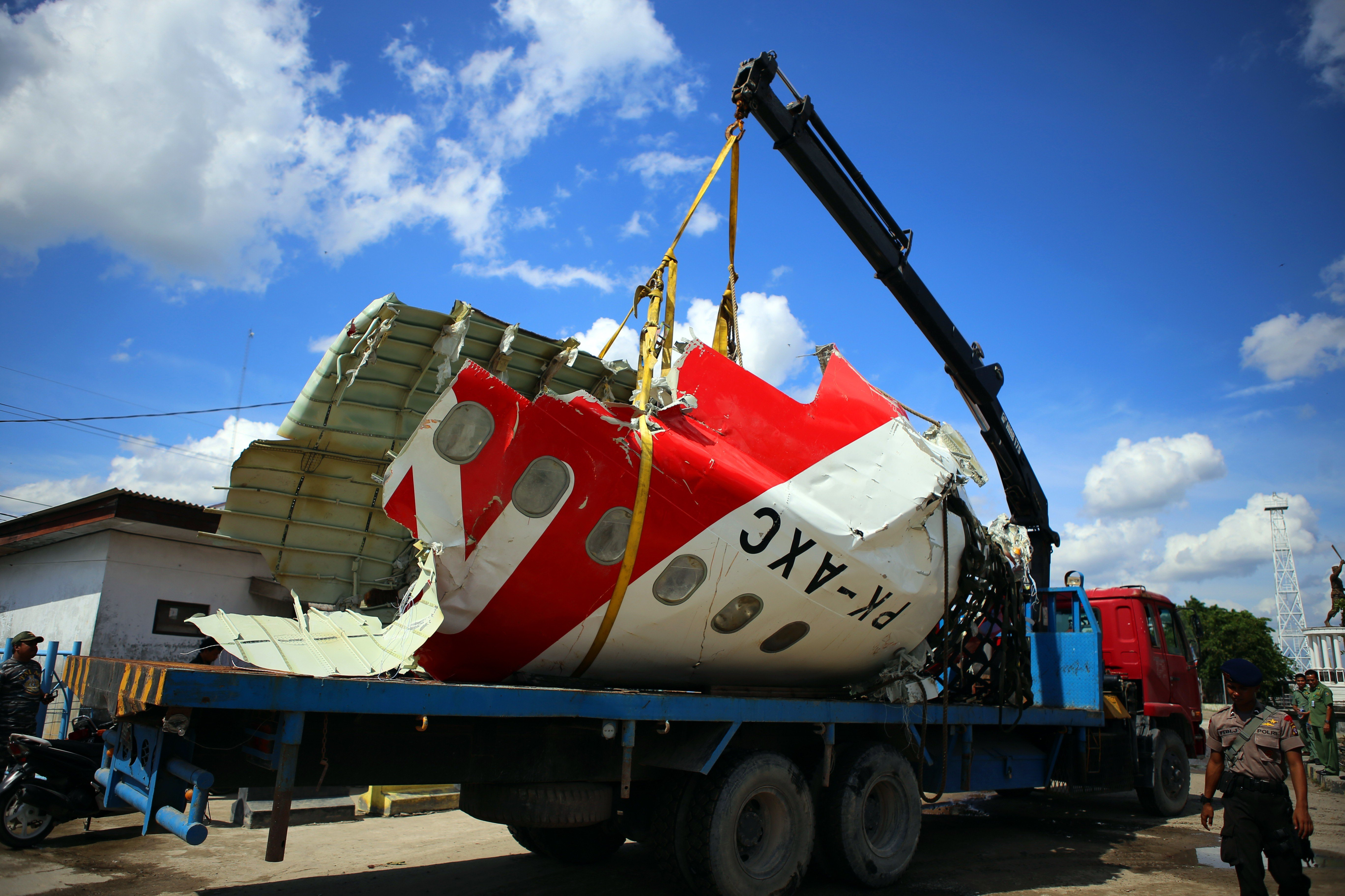 AirAsia aircraft tail is recovered from the Java Sea on Jan. 12, 2015, in Pangkalan Bun, Indonesia