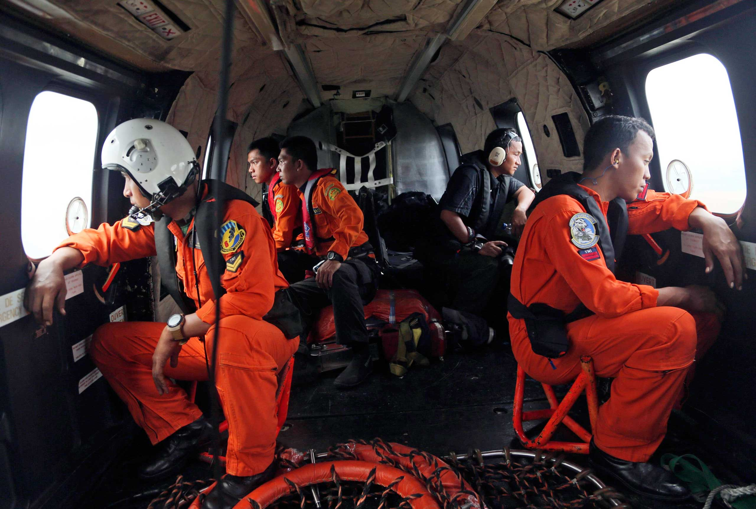 Crewmembers of an Indonesian Air Force NAS 332 Super Puma helicopter search for the victims and wreckage of AirAsia flight QZ 8501 over the Java Sea, Indonesia, Jan. 5, 2015.