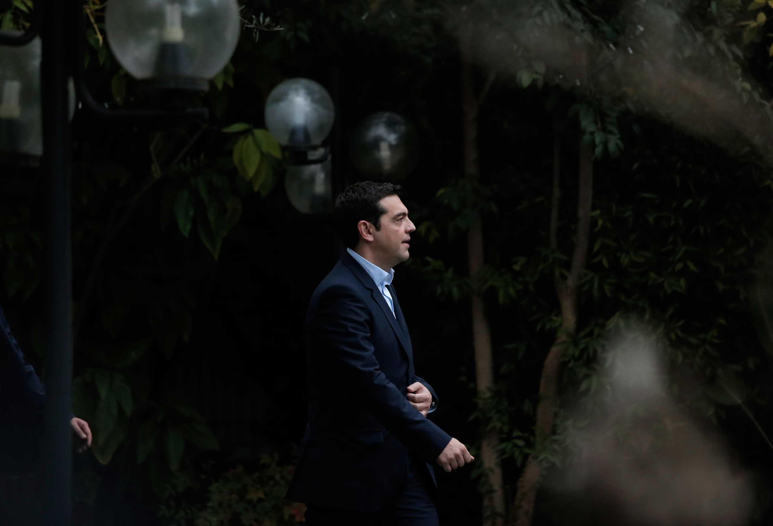 Greece's new Prime Minister Alexis Tsipras arrives at Maximos Mansion, the Greek Prime Minister's official residence in central Athens, Jan. 26, 2015.
