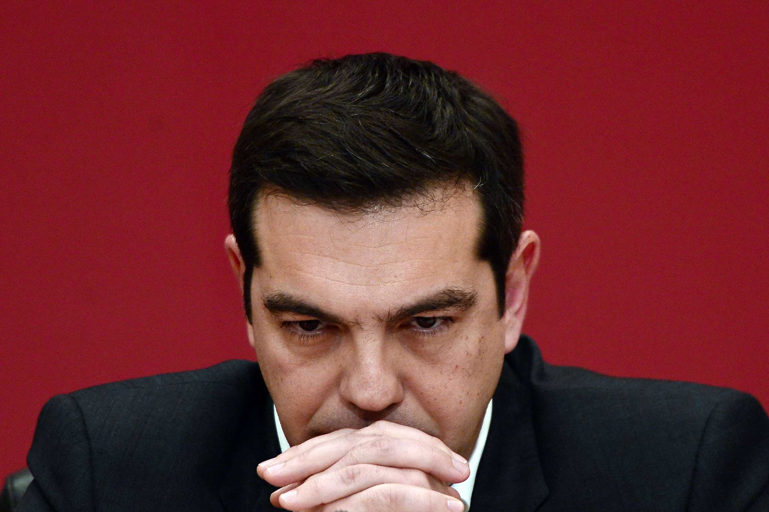 The leader of Syriza party, Alexis Tsipras, listens to a question during a televised press conference on Jan. 23, 2015 at the Zappion Hall in Athens.