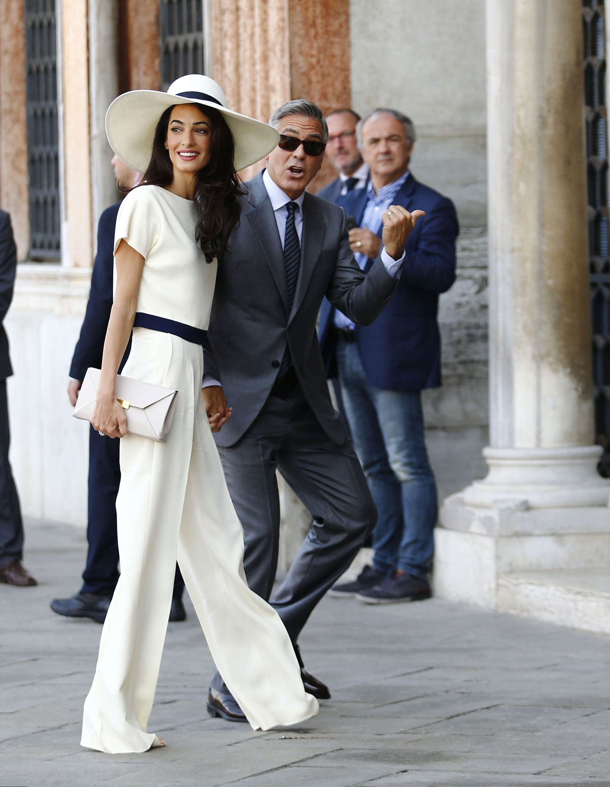 Amal and George Clooney arrive at the palazzo Ca Farsetti for a civil ceremony to officialize their wedding in Venice on Sept. 29, 2014.