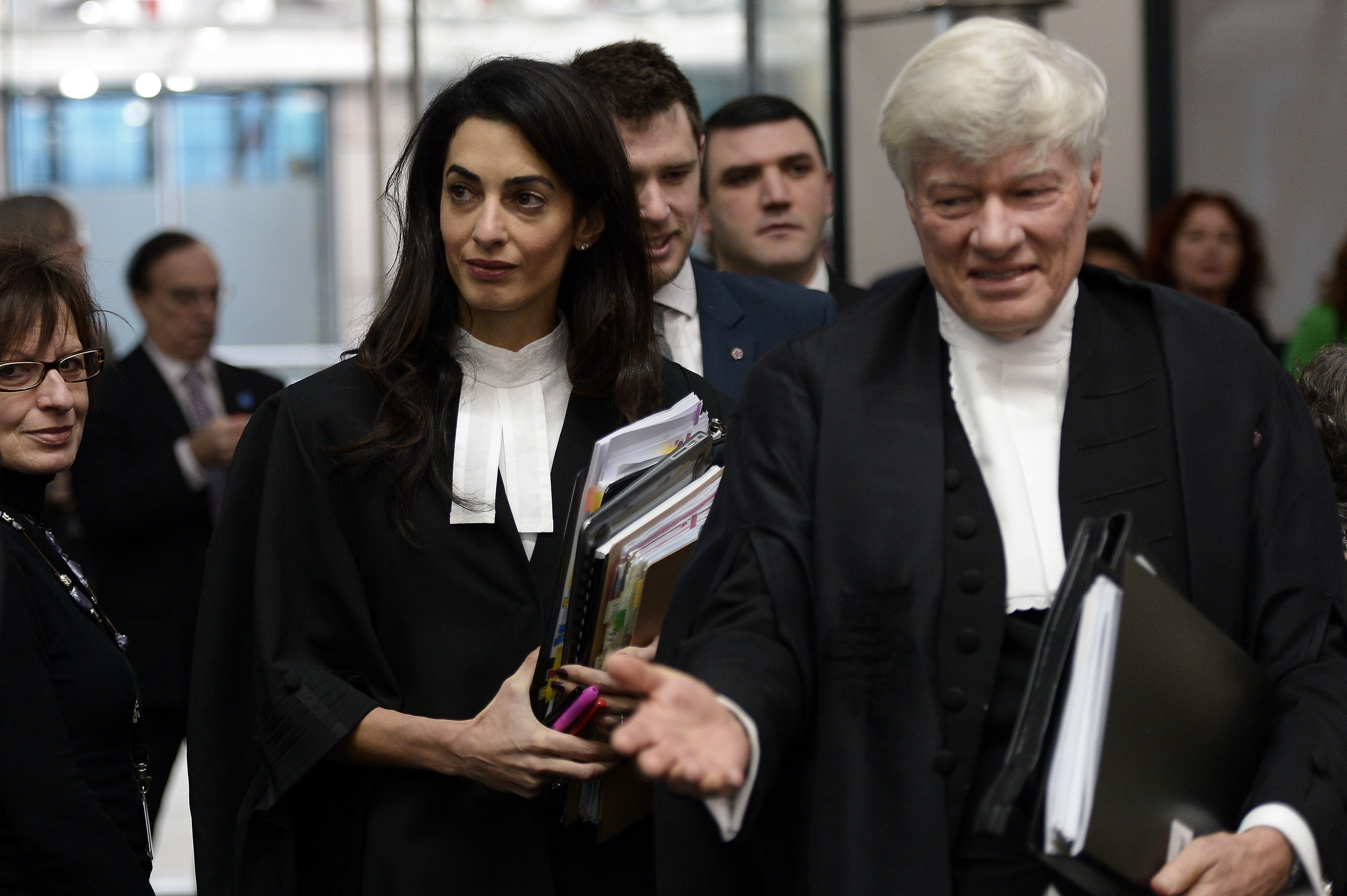 Lawyers Amal Clooney  and Geoffrey Robertso, arrive on Jan. 28, 2015 to attend the appeal hearing in Perincek case before the European Court of Human Rights in Strasbourg, France.