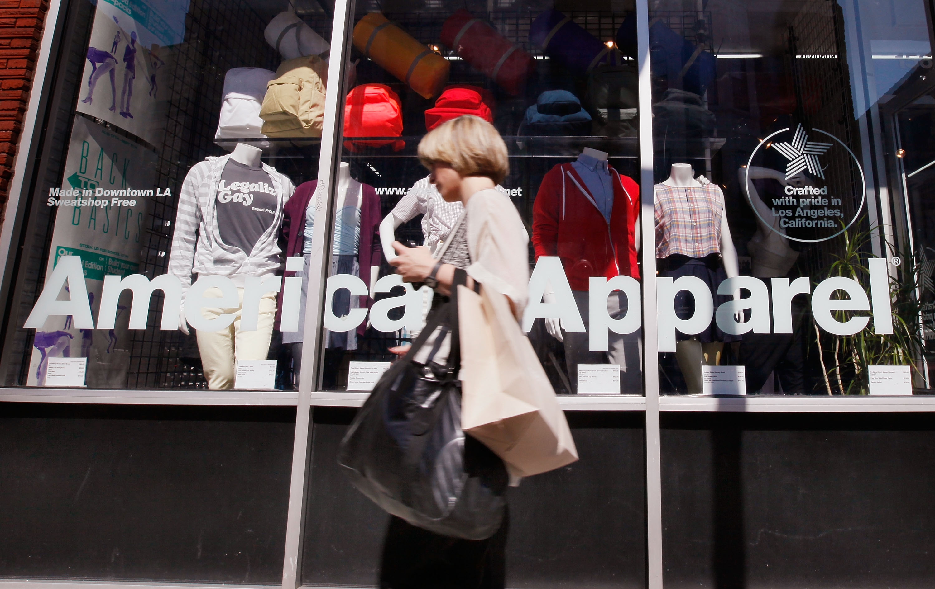 A pedestrian passes by an American Apparel store on Sept. 4, 2009 in Chicago, Illinois.
