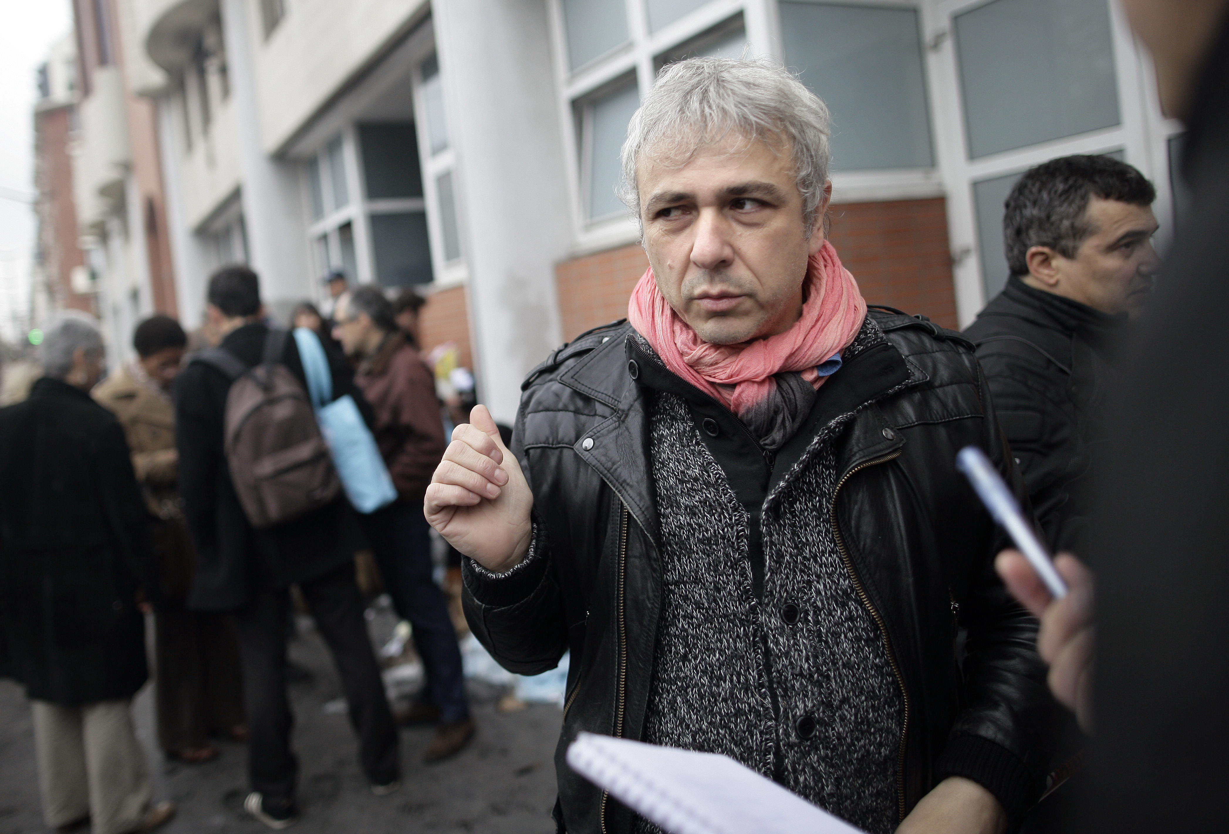 Cartoonist Antonio Fischetti speaks to journalists in front of the offices of French satirical newspaper Charlie Hebdo on Nov. 2, 2011, in Paris after they were destroyed by a petrol-bomb attack overnight