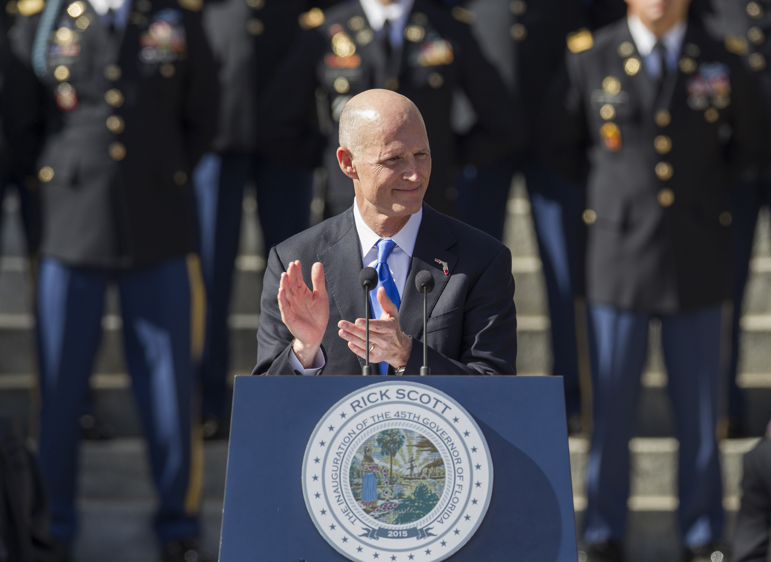 Florida Governor Rick Scott applauds during his speech after the swearing in for his second term as governor of Florida at the Florida state capitol in Tallahassee, Fla. on Jan. 6, 2015.