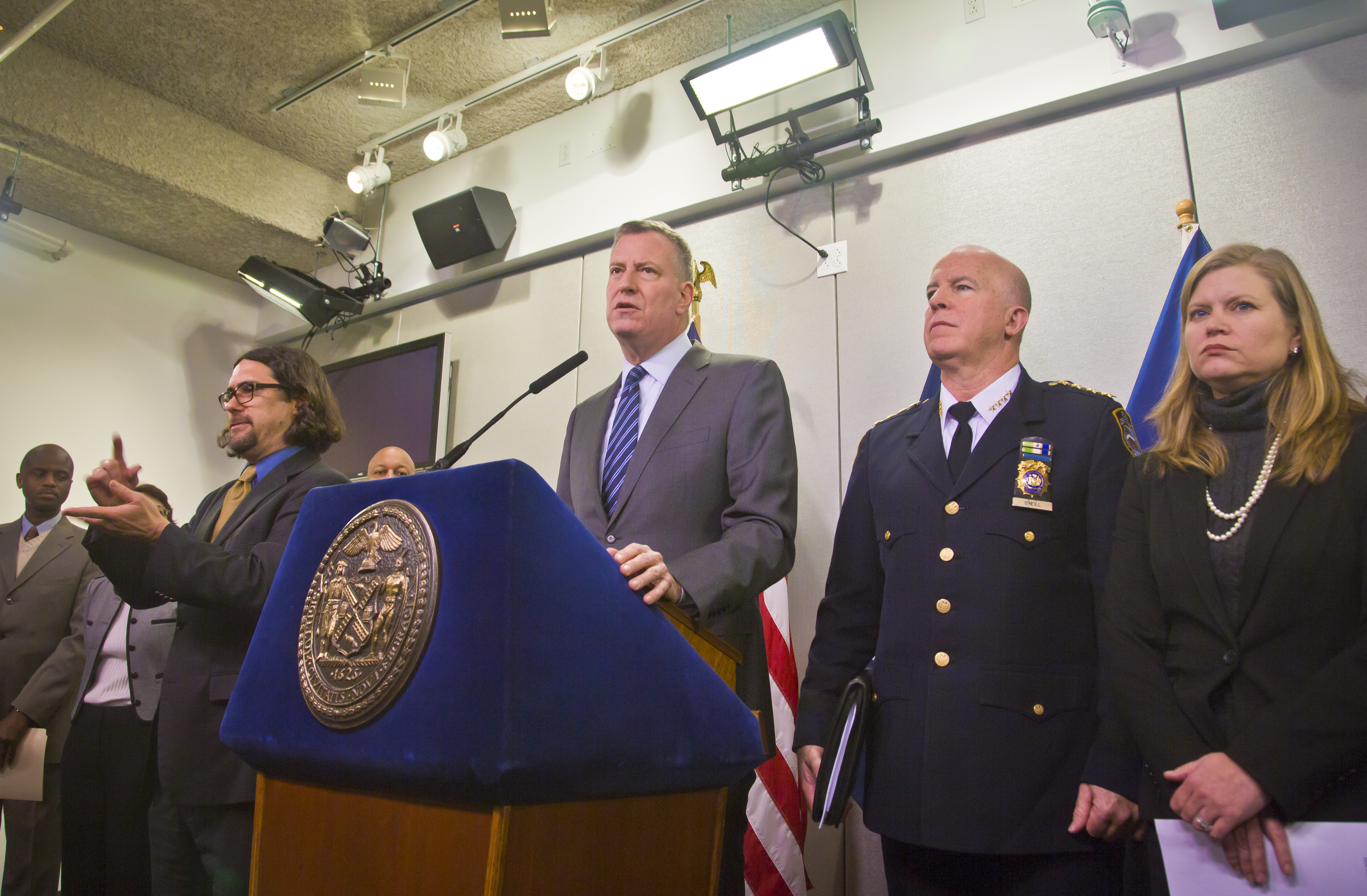 New York City Mayor Bill de Blasio, center, and top city officials hold press conference at the city's Office of Emergency Management, Monday, Jan. 26, 2015, in New York