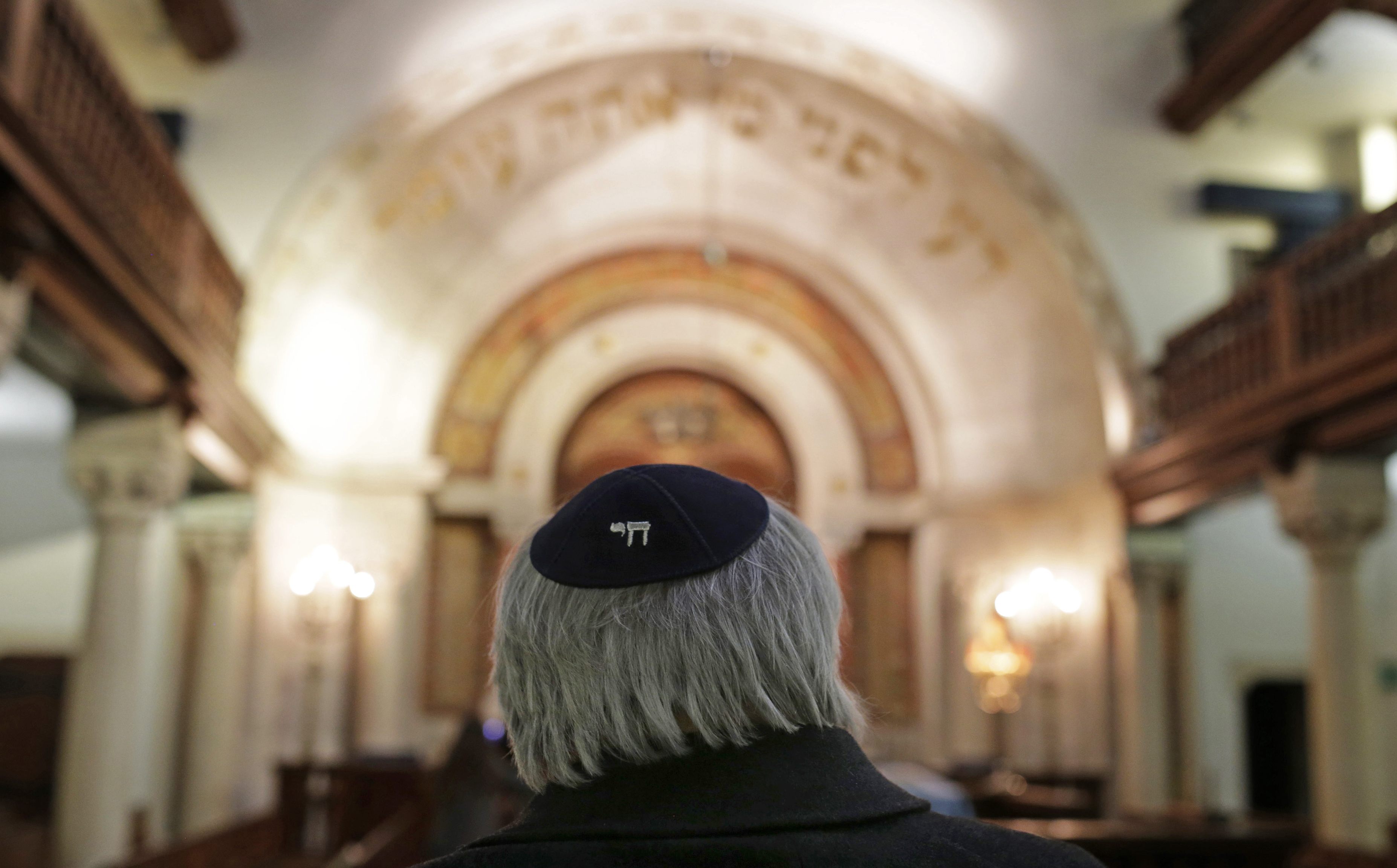 In this photo taken on Wednesday, Jan. 28, 2015, Jose Oulman Bensaude Carp, President of the Jewish community in Lisbon, waits to be interviewed by The Associated Press at the main Jewish synagogue in Lisbon.