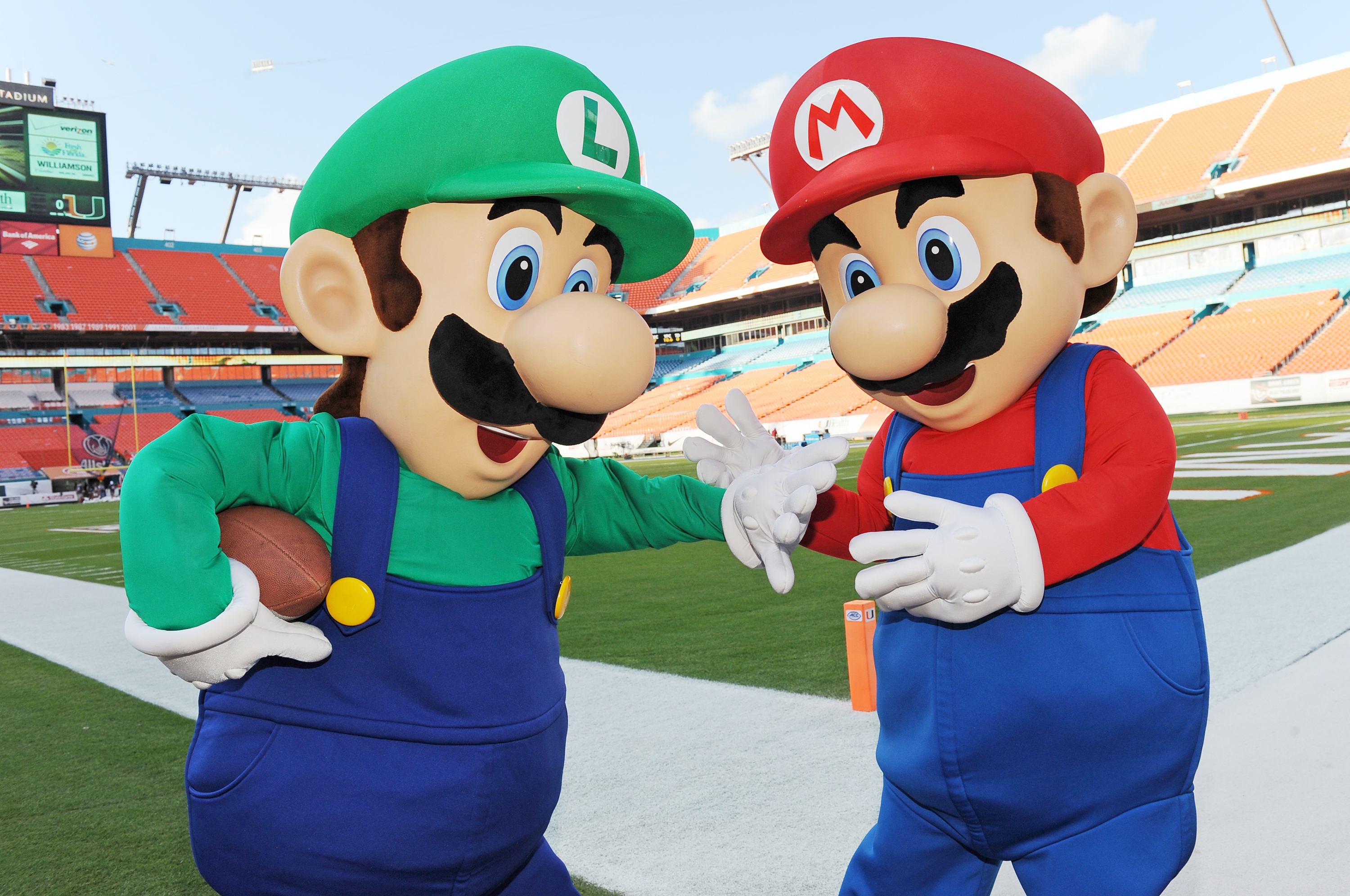 Mario and Luigi take the field at Sun Life Stadium before the face-off between Florida State and University of Miami on Nov. 15, 2014.