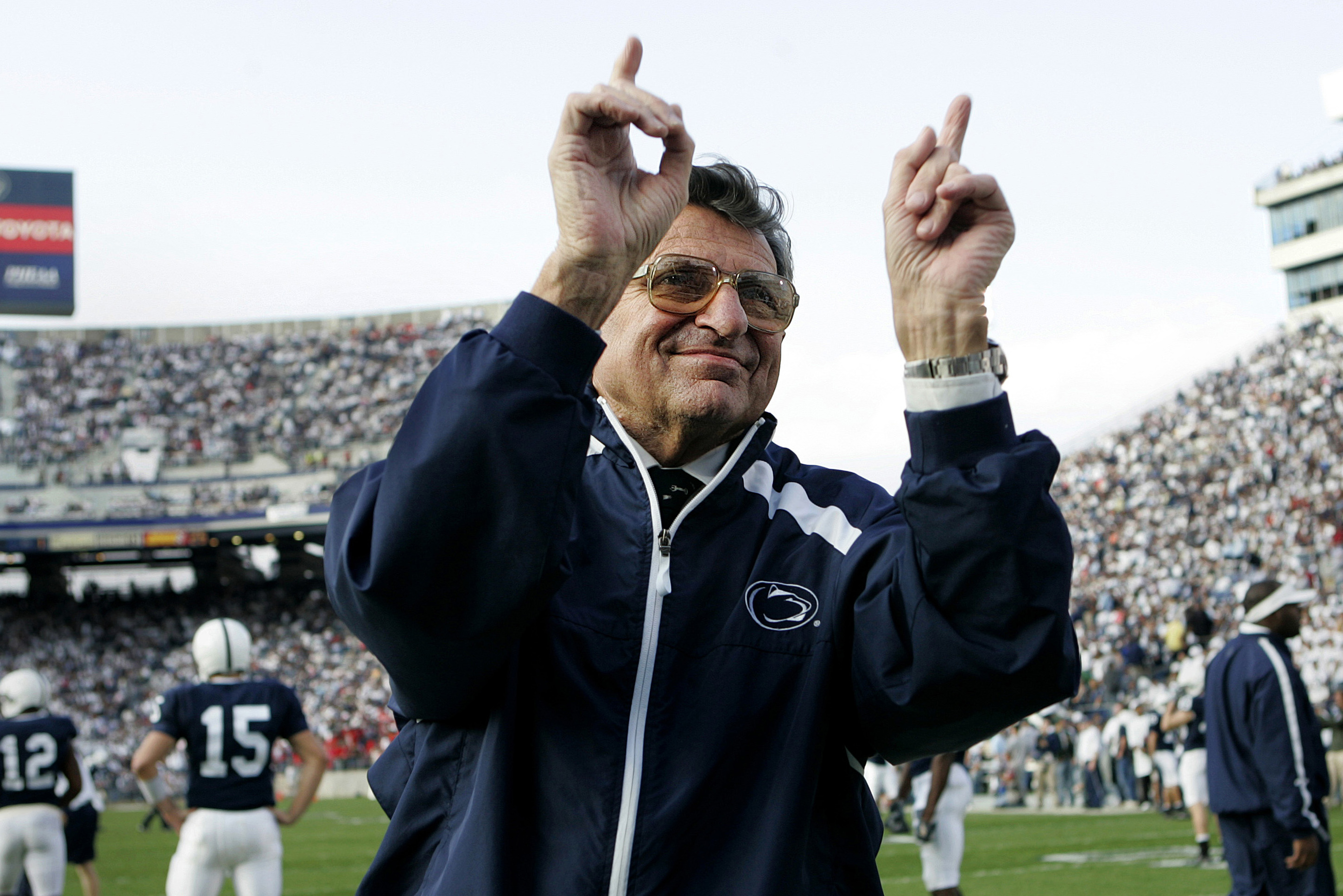 Penn State football coach Joe Paterno acknowledges the crowd before an NCAA college football game against Wisconsin in State College, Pa. on Nov. 5, 2005.