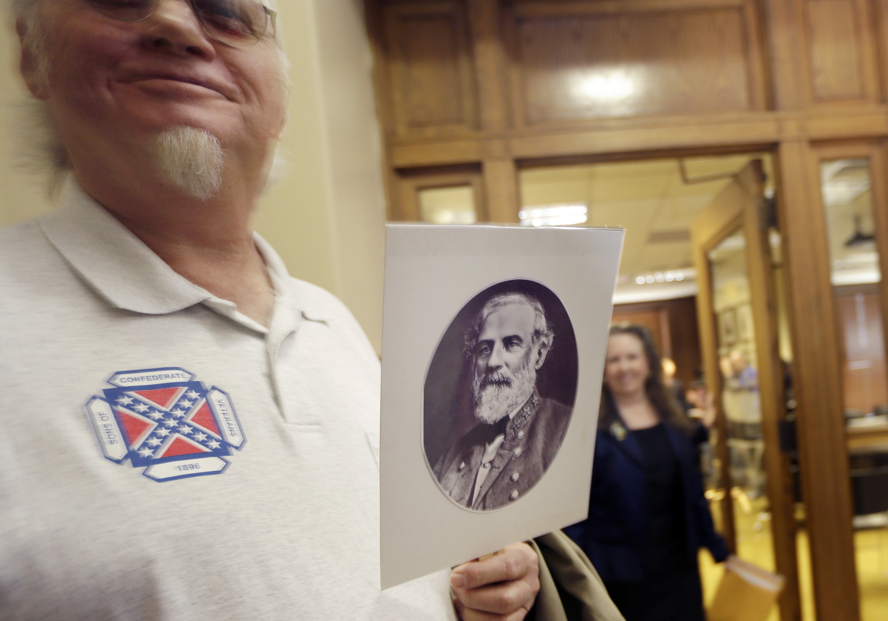 Dewey Spencer, of Judsonia, Ark., holds a portrait of Confederate Gen. Robert E. Lee after a meeting of the House Committee on State Agencies and Governmental Affairs, Wednesday, Jan. 28, 2015, at the State Capitol in Little Rock, Ark.