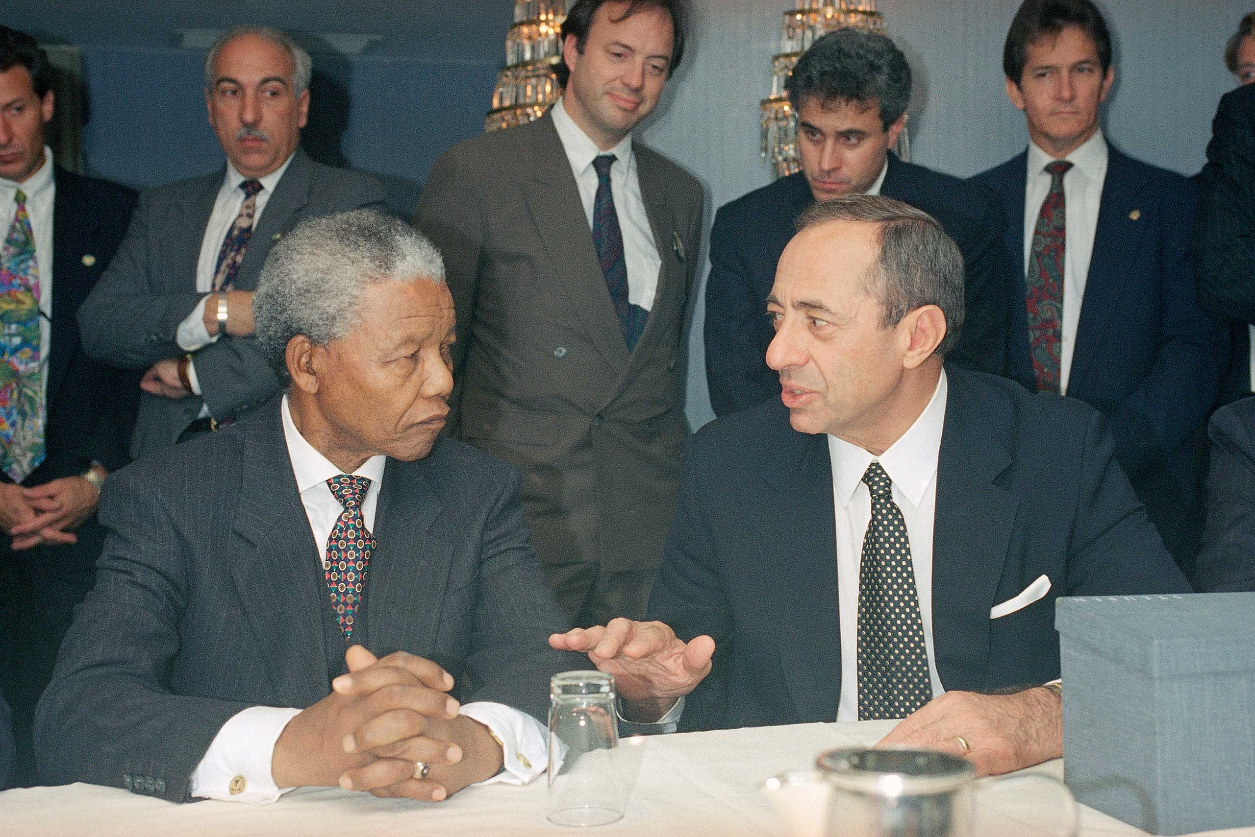 New York Governor Mario Cuomo, right, converses with South African President Nelson Mandela at the Inter-Continental Hotel in New York City on Oct. 2, 1994.