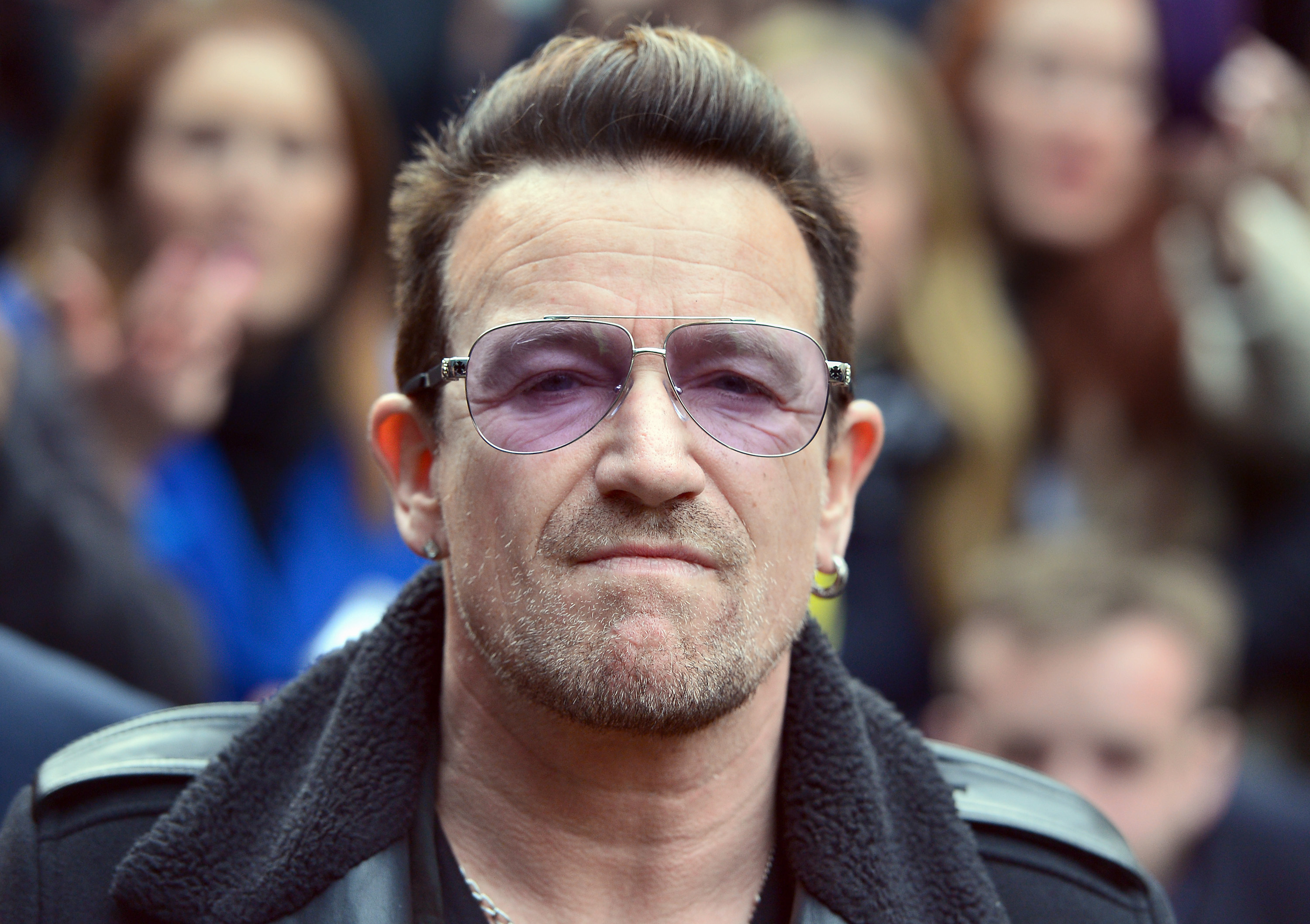 Bono of U2 arrives for the recording of the Band Aid 30 single at Sarm Studios in Notting Hill, London, Saturday November 15, 2014.