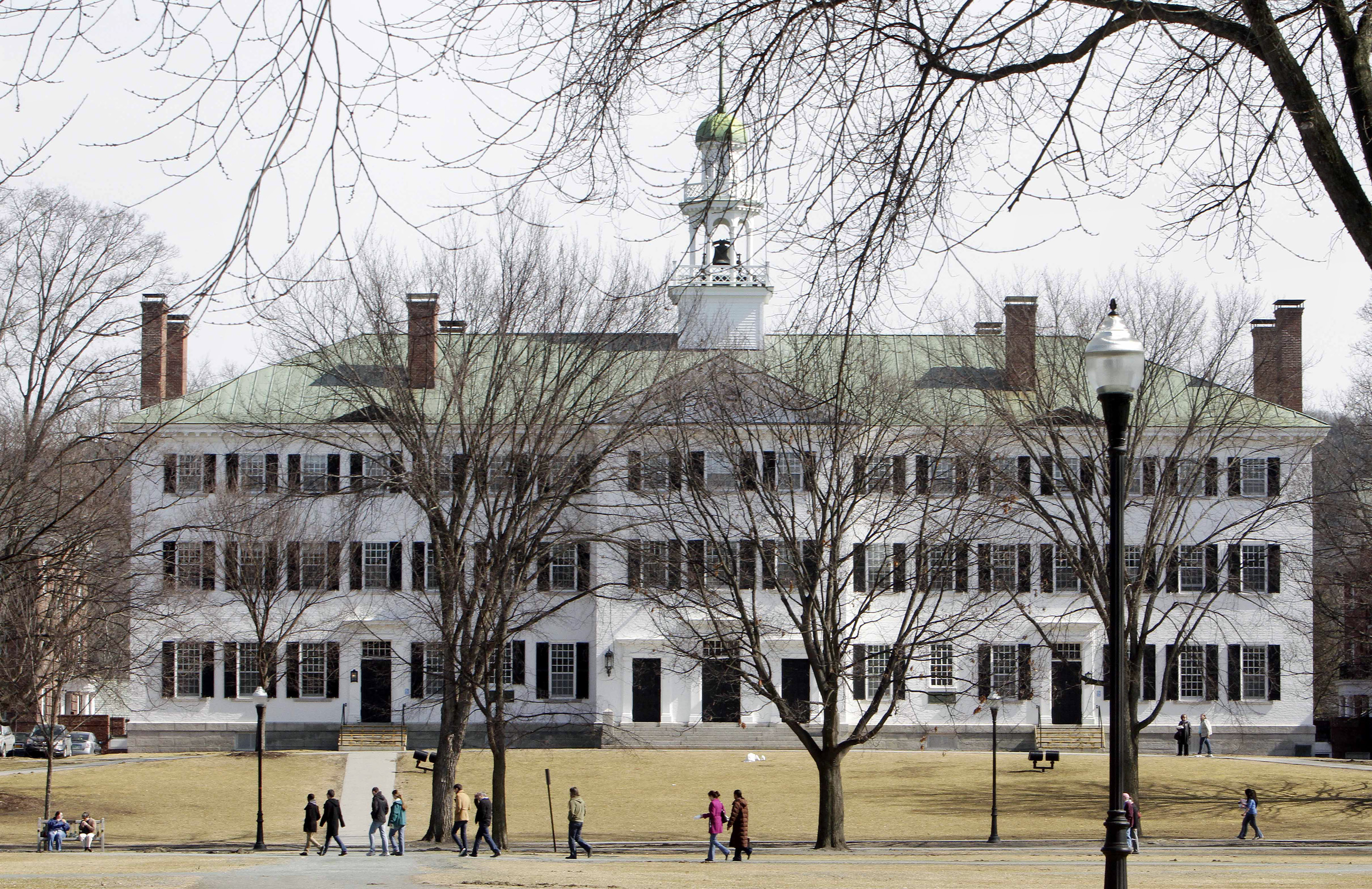 Students walk across the Dartmouth College campus green in Hanover, N.H., on March 12, 2012. The school is banning hard alcohol on campus.